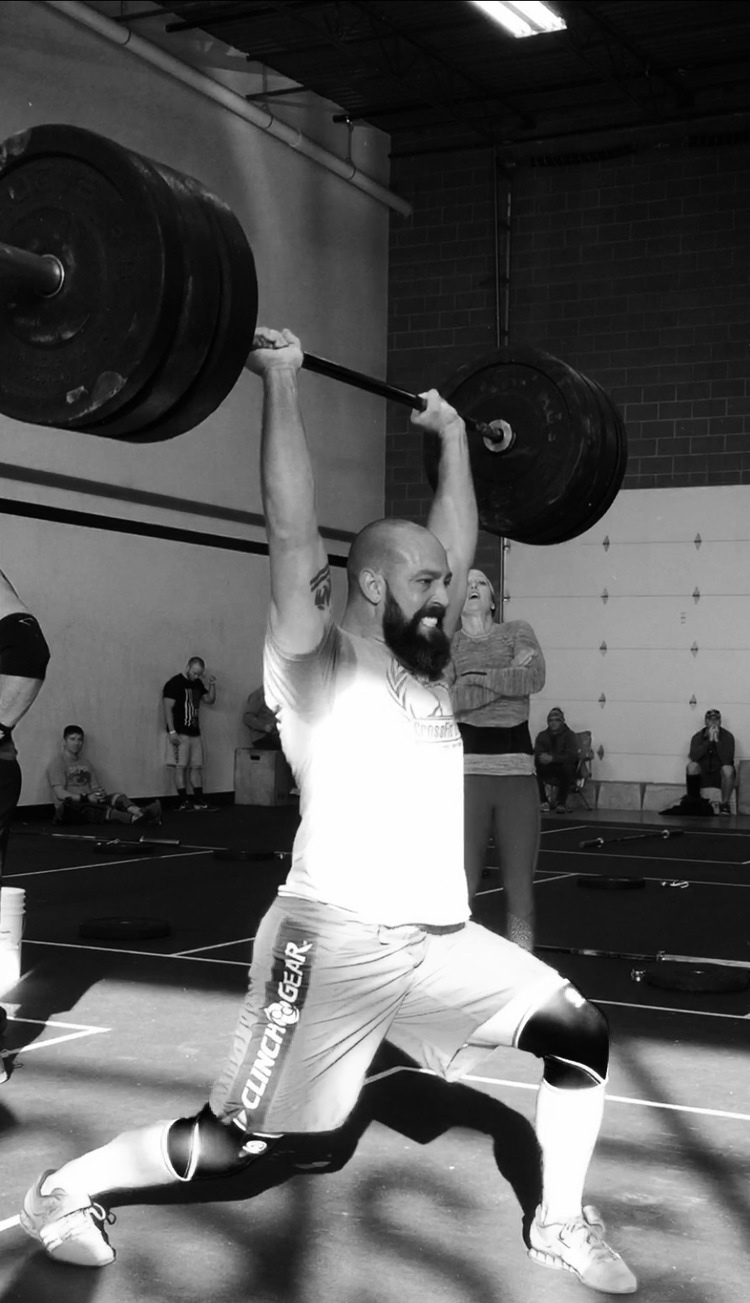Coach Jessie Smith lifting at CrossFit Edify