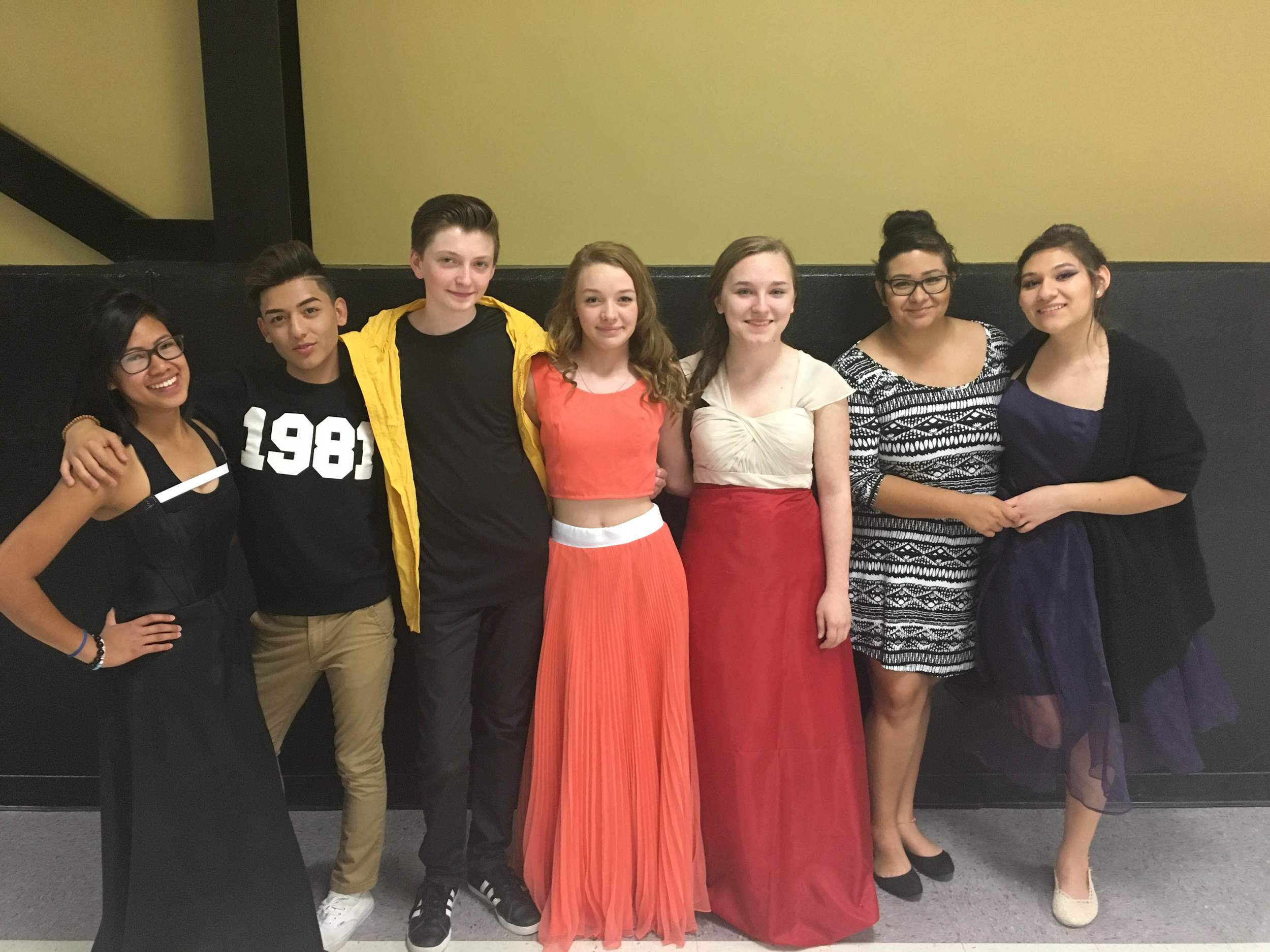 The students created four looks: an elegant black gown on left, the two peach dreams in the middle, and the black and blue beauty on the right.