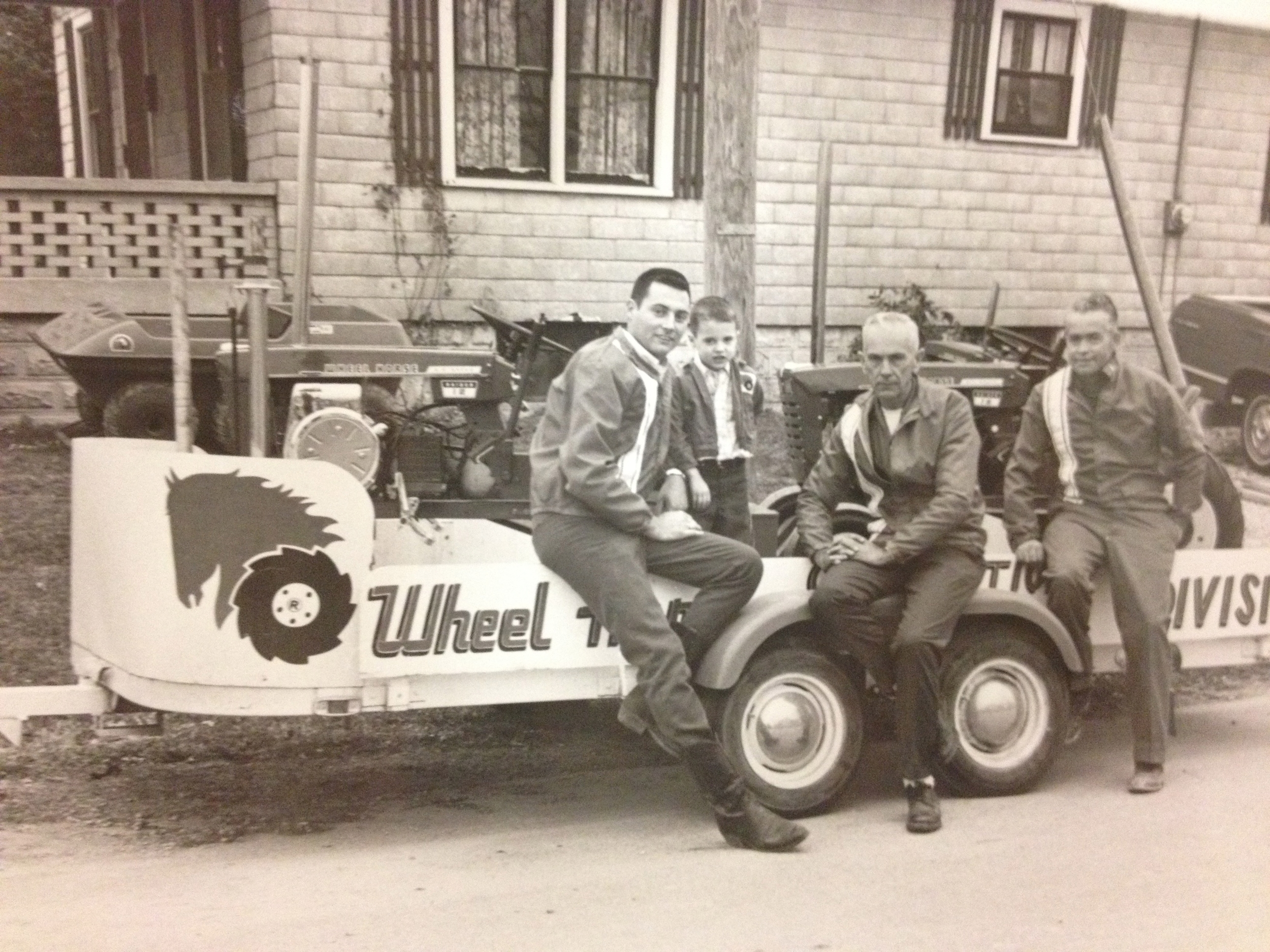 Phil,  young Brian, Woody Porter and George York made up the Humphreys' Wheel Horse pulling team.