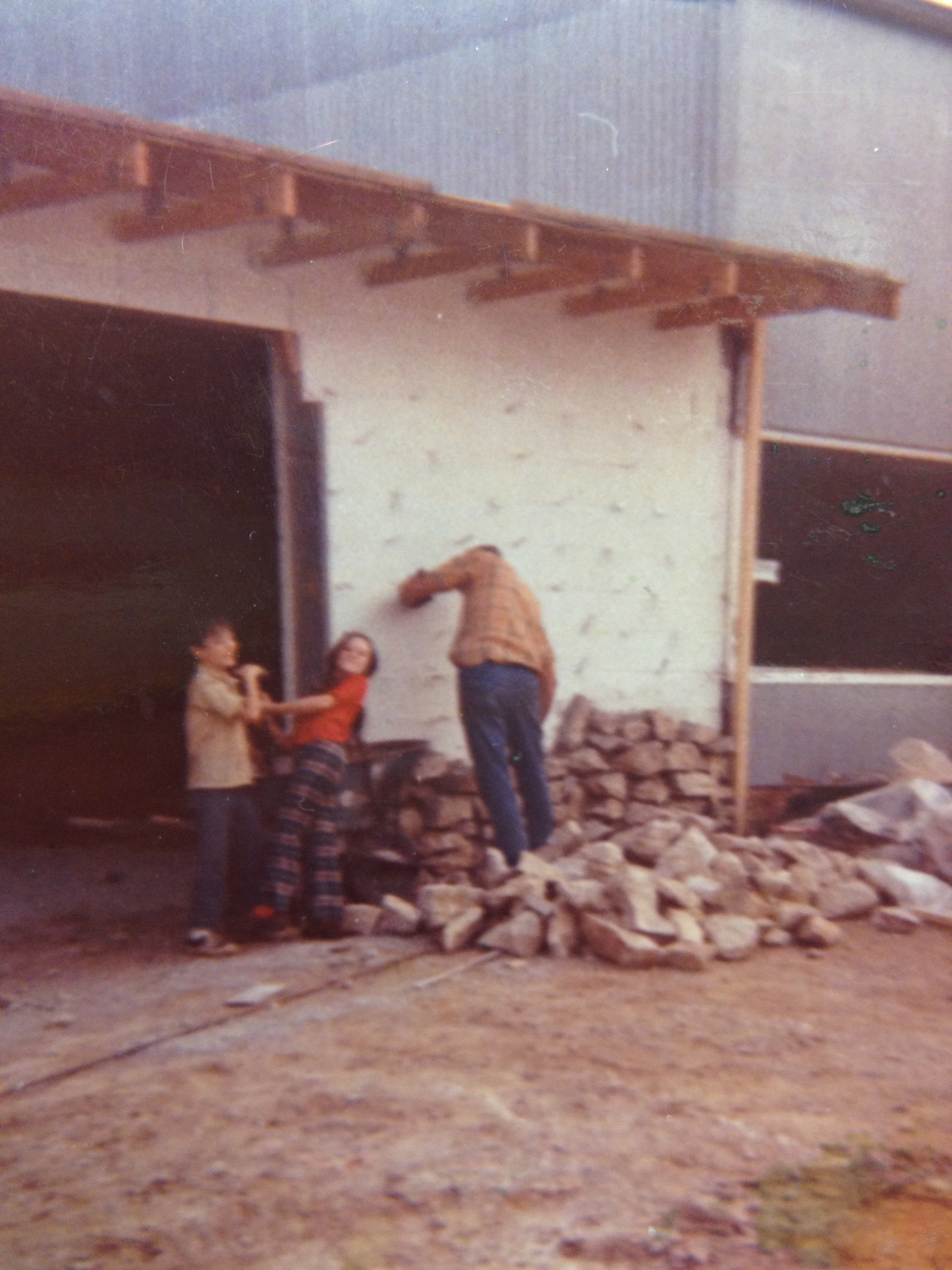 Brian and Ginger Help Phil lay rock at the new shop circa 1972