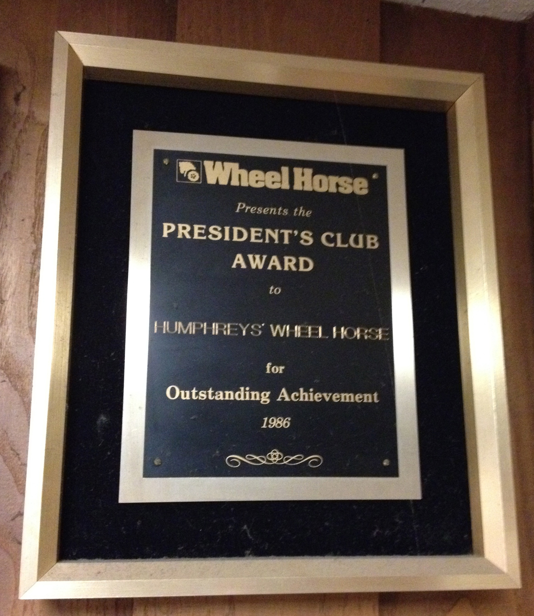 The Presidents Club award from Wheel Horse for outstanding achievement in sales and service. Humphreys' has won this award every year from 1985-1989