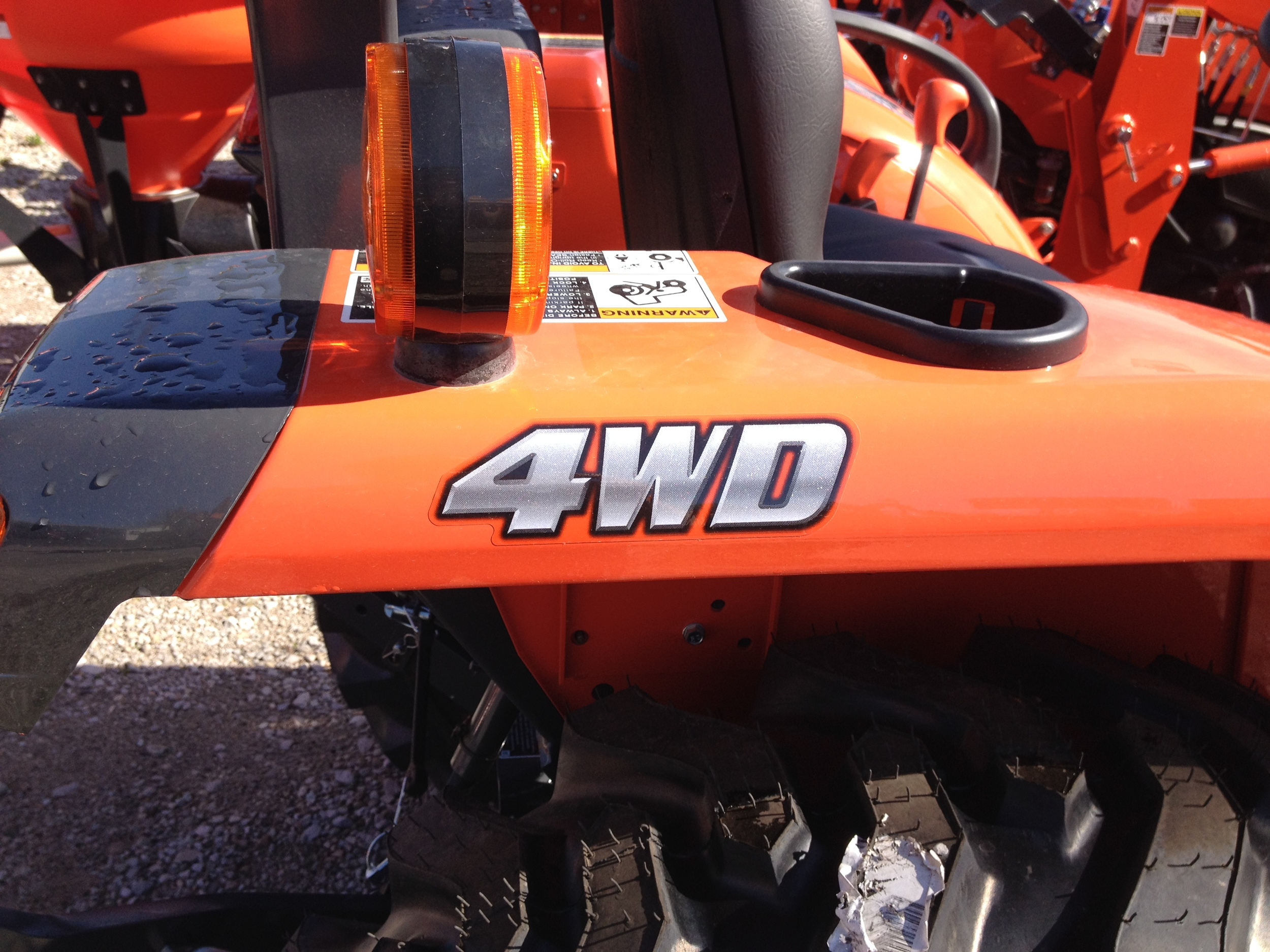 4WD means four wheel drive, but also signifies its a standard gear drive tractor