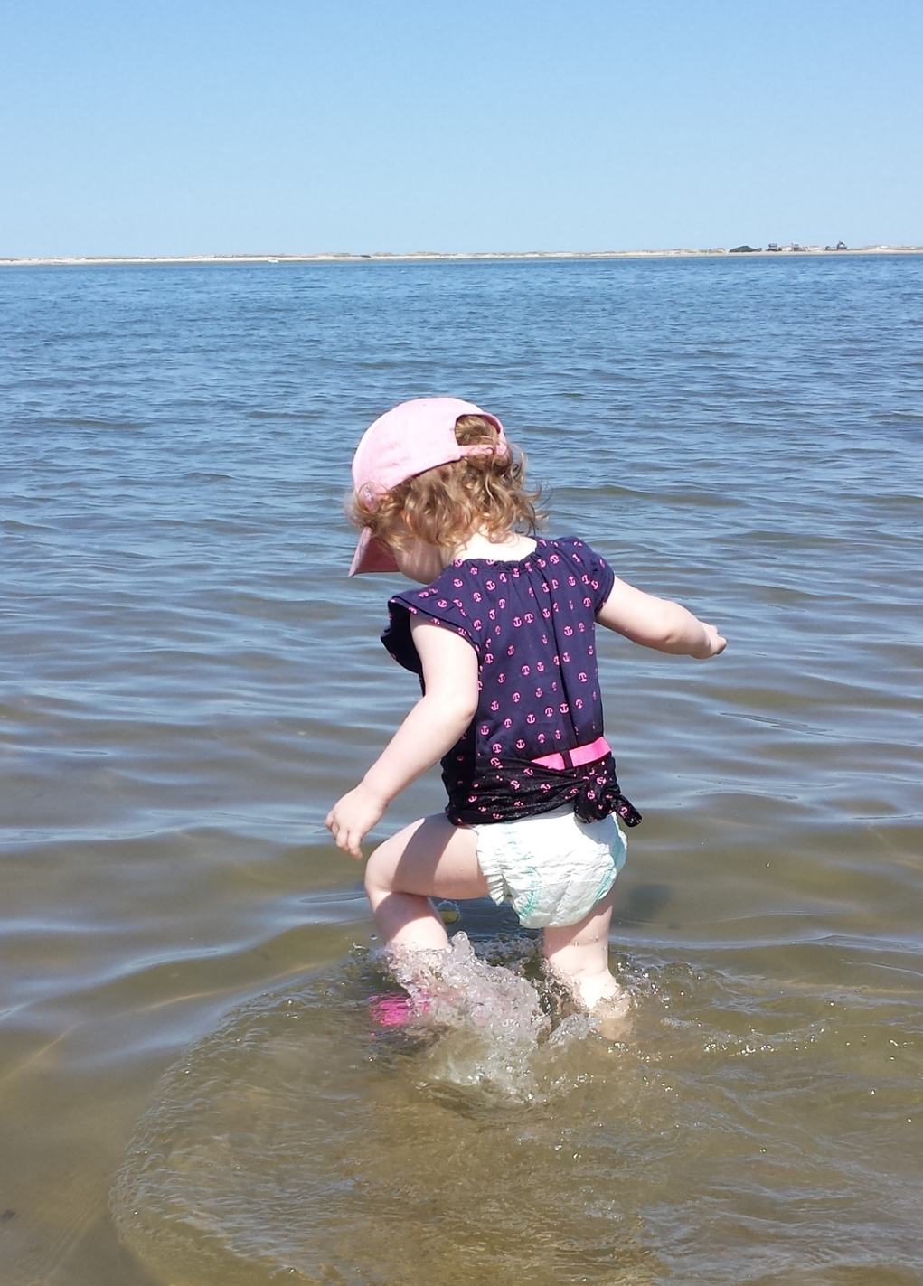 My daughter never lets being fully clothed get in the way of a good swim.