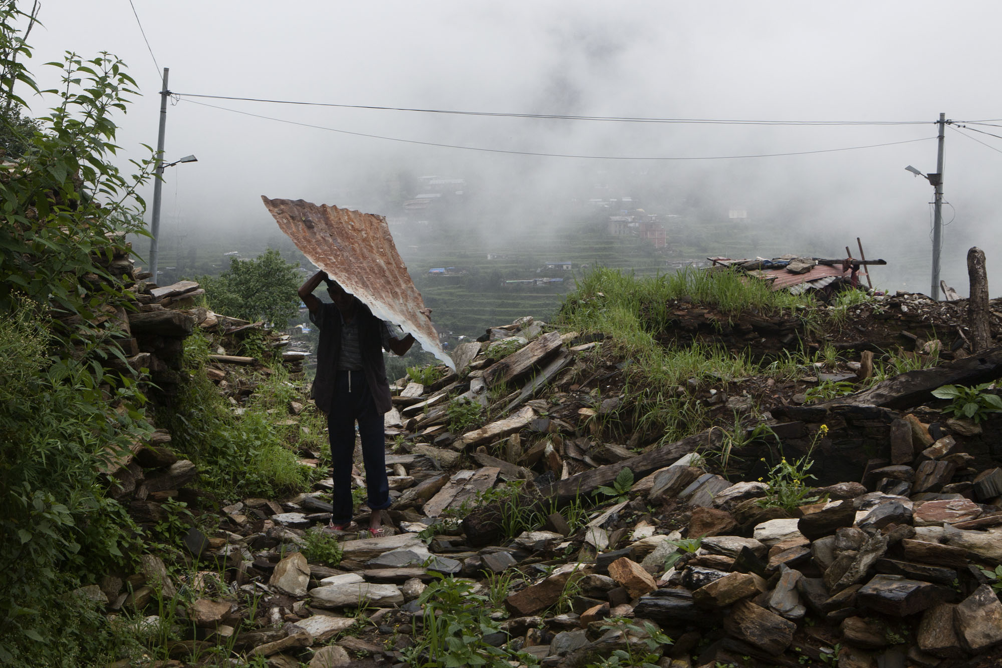 Prembahadur Shrestha age 65, works to clear rubble from his home. Tauthali Village ward No.3 Sindupalchowk District, Nepal. August 5, 2015.