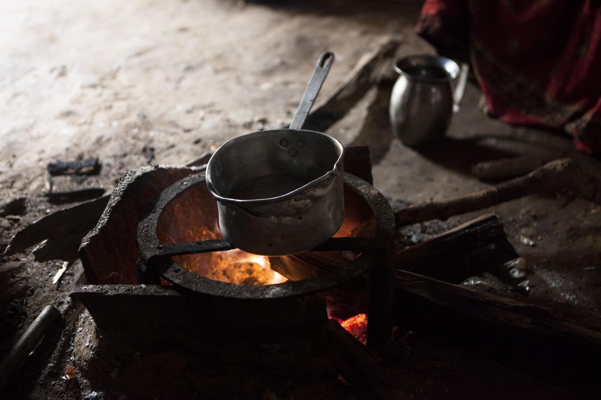 Surjakumari Sherstha age 60 prepares to make tea inside of her temporary shelter. Tauthali Village ward No. 3, Sindupalchowk District, Nepal. August 6, 2015.