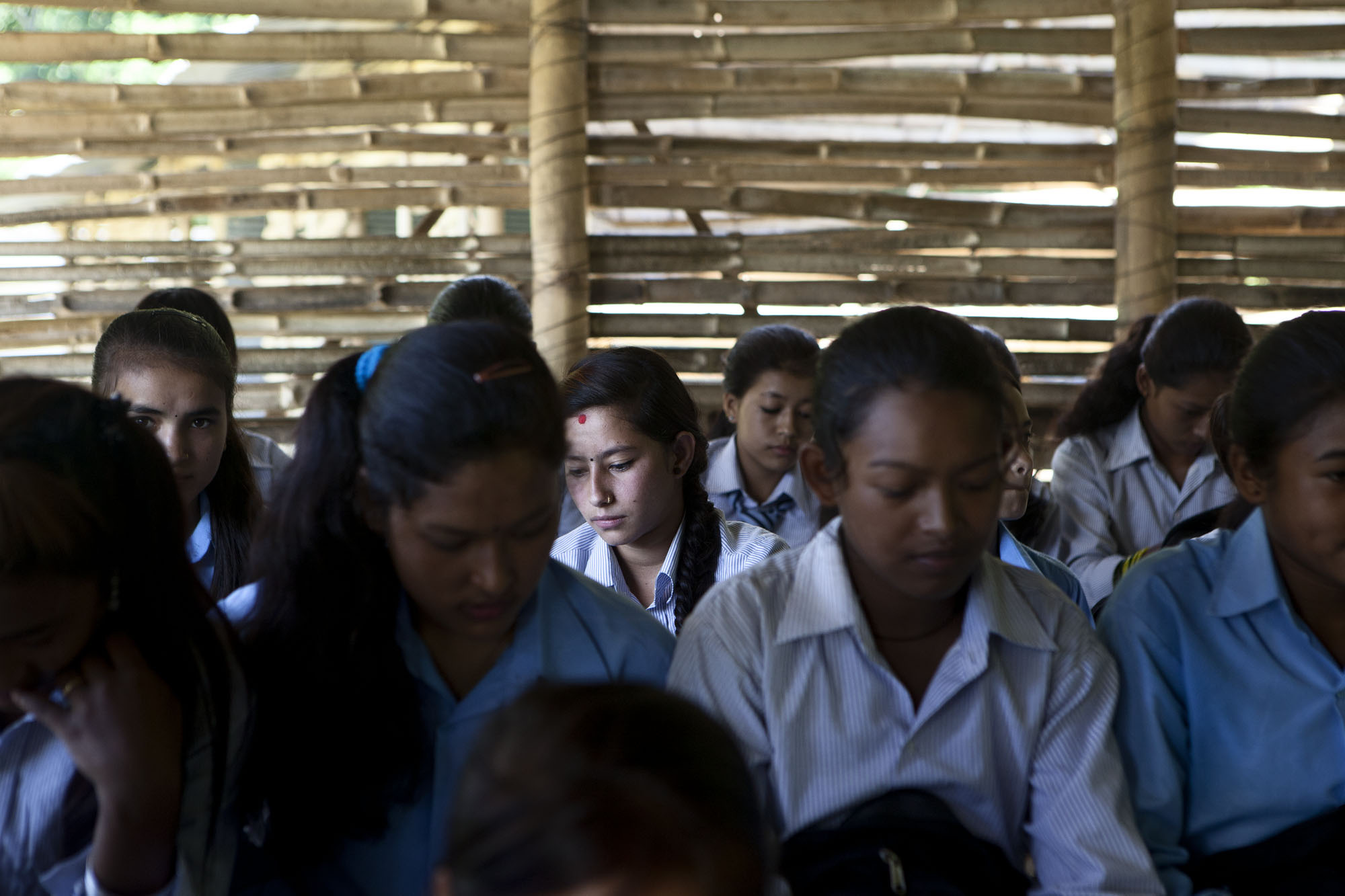 Kids of the Kaalidevi higher school attend class inside of a temporary school made of bamboo. Private and government schools have now reopened. Kadamnas Village ward no. 4. Sindupalchowk District, Nepal. August 3, 2015.