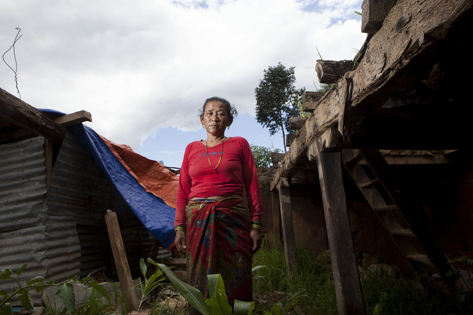 """Chinimaya Tamang age 40 """"When I saw my home everything was totally collapsed. Just now things are becoming all right, now we are getting relief for food, but still big problem is drinking water"""". Kadambas Village ward No. 3 Sindupalchowk Disrict, Nepal. August 3, 2015."""