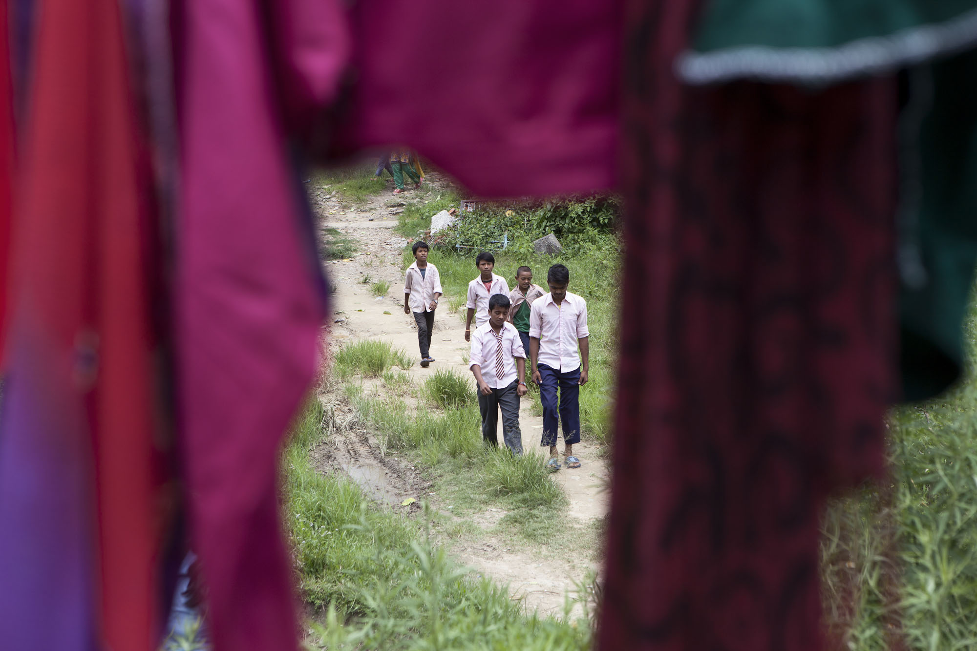 Kids leave school in the Kadamnas Village ward no. 4. Private and government schools have now reopened. Sindupalchowk District, Nepal. August 3, 2015.