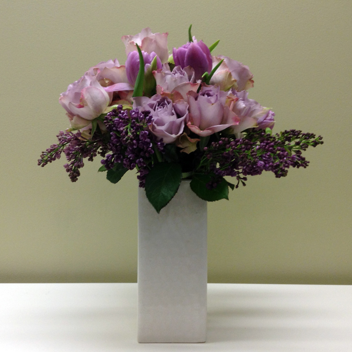 purple-roses-and-tulips-in-square-vase.jpg