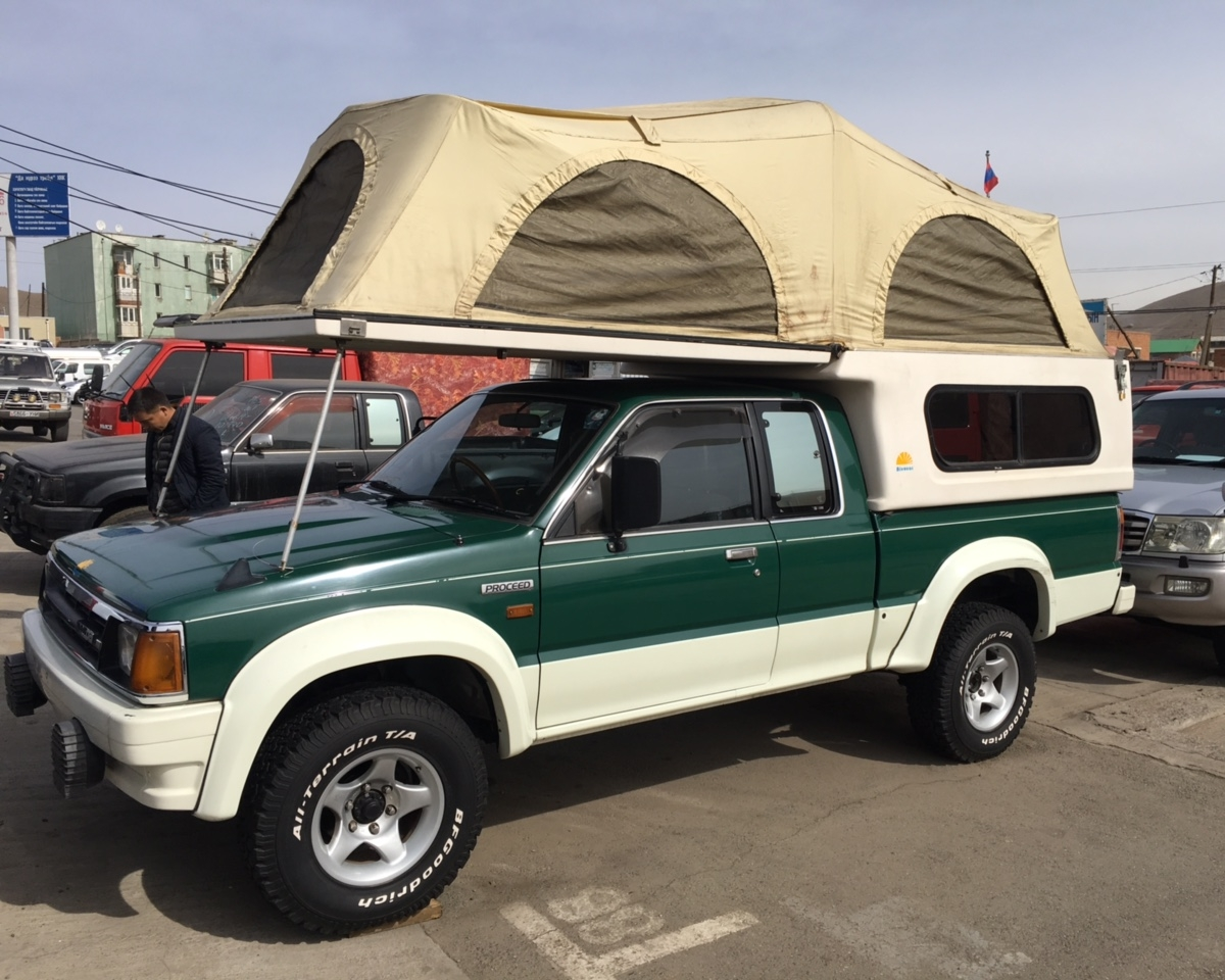 "MAZDA PROCEED, PETROL, MECHANIC, WITH ROOF TENT DESIGNED FOR 2 PAX. ALL OUR CARS ARE EQUIPPED  WITH ""ARB"" BUMPER AND WINCHES. WE'LL PROVIDE TWO EXTRA TIRES. ROOF TENTS ARE OPTIONAL AND IT CAN BE INSTALLED IN EVERY VEHICLE. AND WE HAVE ""LUGGAGE STORAGE SERVICE"" WITH FREE OF CHARGE."