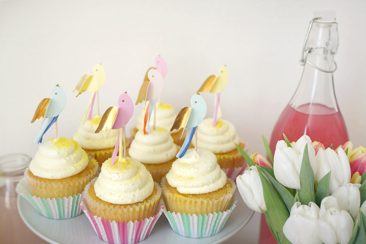 lemon cupcakes with bird toppers