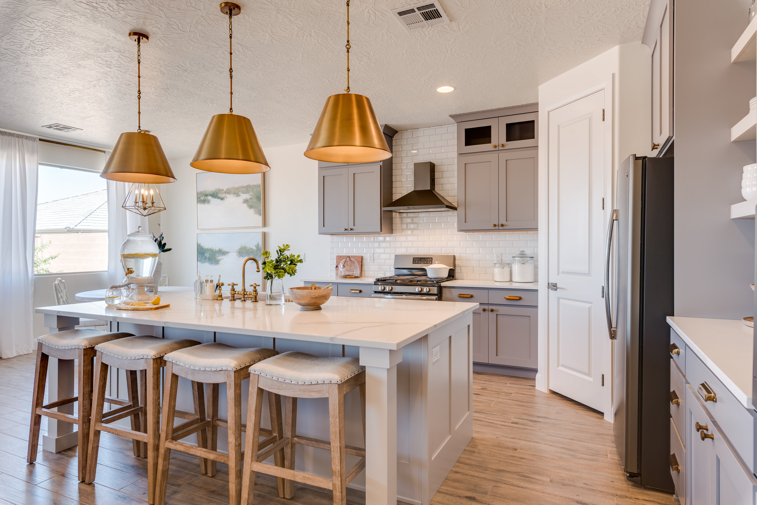 gray painted cabinets with brass accents