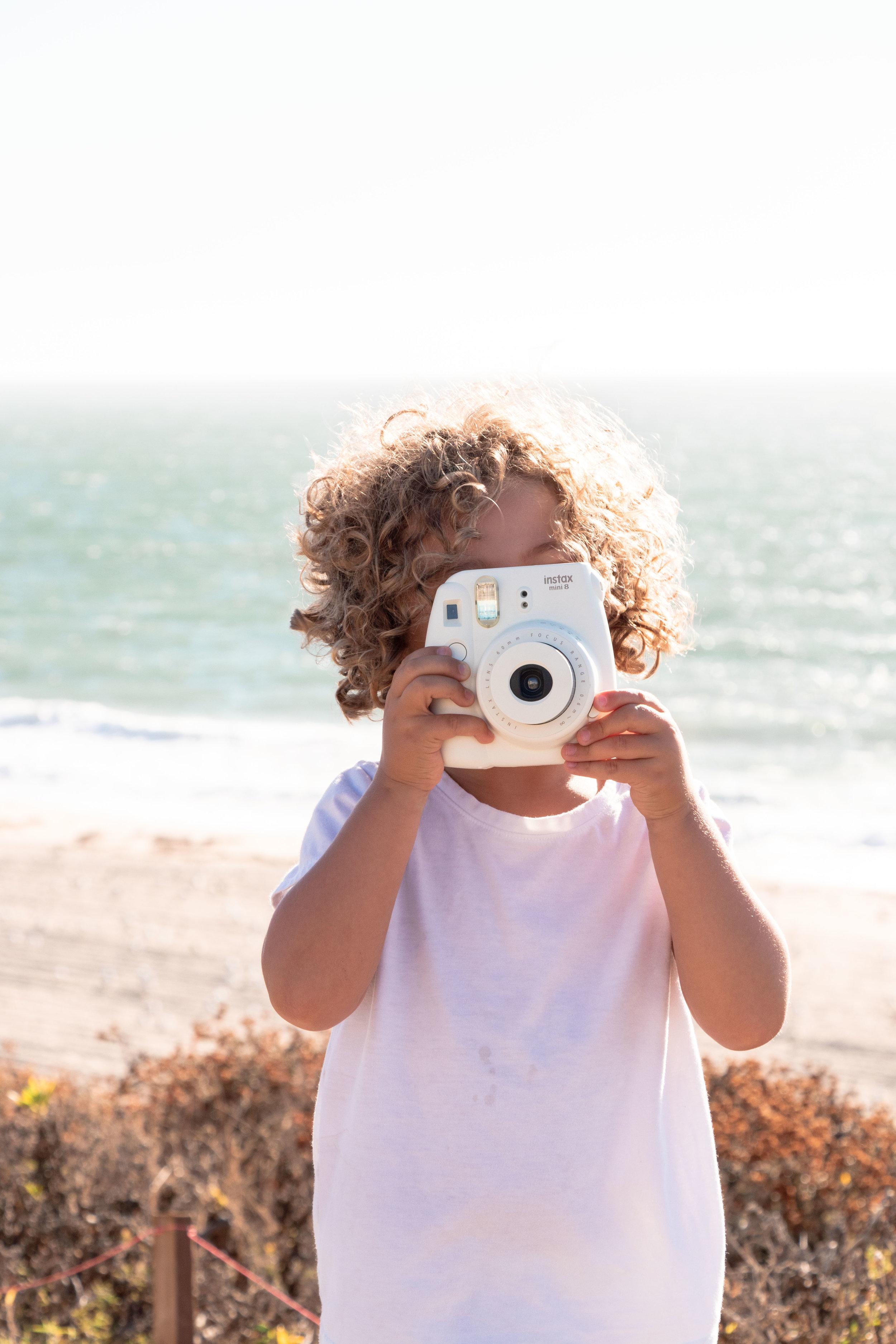 taking photos at the beach