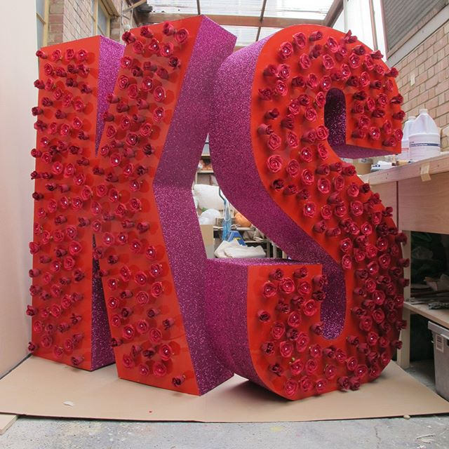 Flashback Friday - Giant letters with light up roses and pink glitter. Used as a back drop for a pop-artist with initials KS. . . . . #sculpture #artwork #design #installation #fabricator #propmaking #craftspeople #designfabrication #maker #bespoke #artfabricators #eventdesign #marketing #installation #modelmaking #modelmakers #manufacturing #art