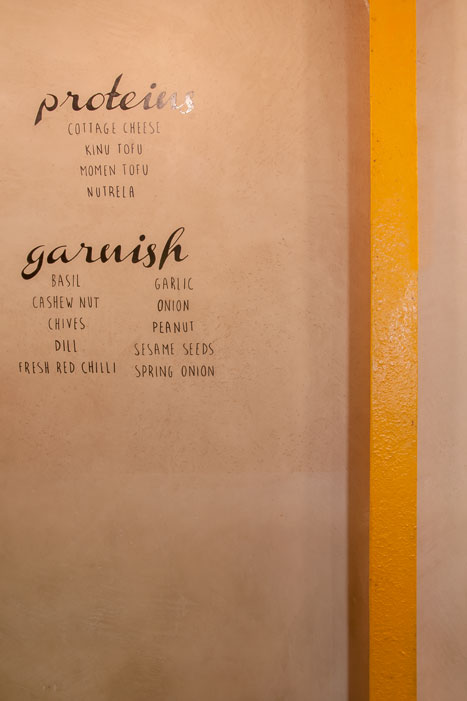WRITING ON TEXTURED WALL SURFACE BY NEHA KAMATH
