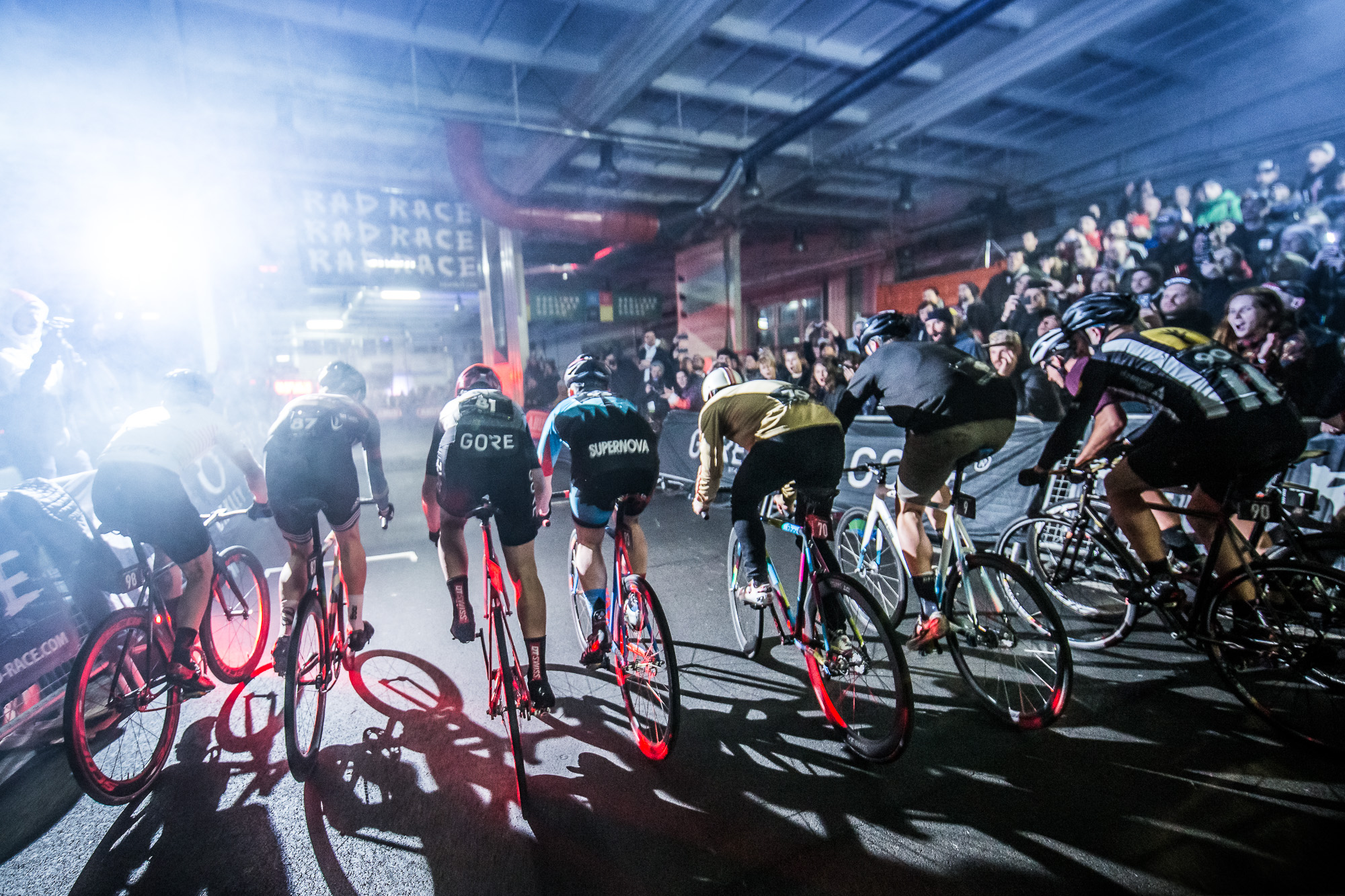 INFO: - RAD RACEing at it's finest! Some of you know already what we're talking about but for everyone else here is a short summary: A go-kart race track in Berlin, 128 male competitors, 40 female riders, fixed-gear only – until only one is still standing!