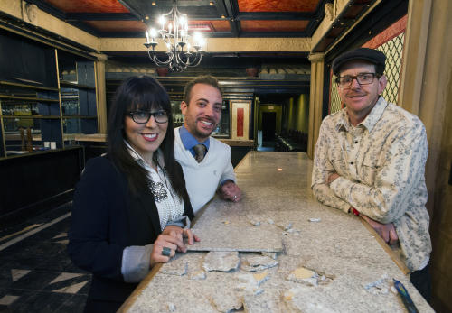 Toni and Tony Calderone, left, with their executive chef Scott Robinson inside the former Colosseo building in the 100 block of North George Street. The group plans to open Tutoni's in the space in April. They are demolishing the first-floor bar to make more space for dining. (DAILY RECORD/SUNDAY NEWS -- Paul Kuehnel)