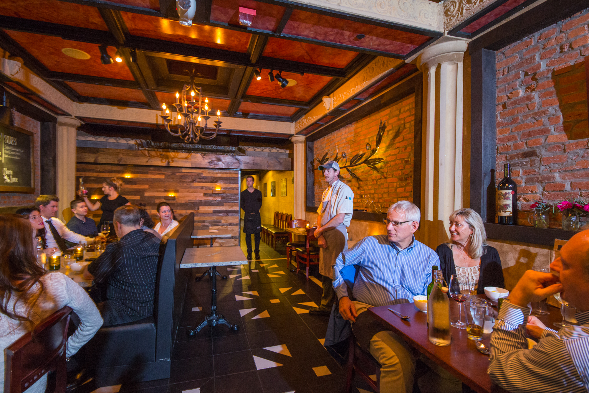 Downstairs Dining Room - This intimate space is sultry and romantic. It is also handicap accessible and has easy access to bathrooms. It is perfect for smaller gatherings and most often used for private chef's tables so the chef can come from the kitchen and explain each dish. Seats 20-36.