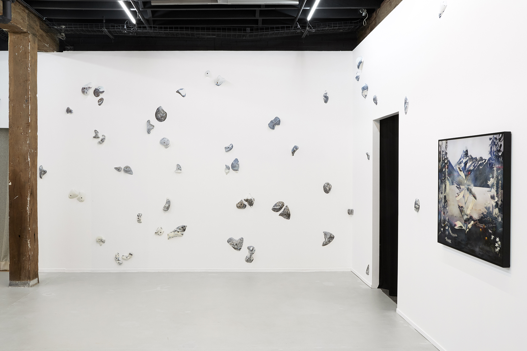 Left to right: Kai Wasikowski, 'Climb, grip, hold,' 2018, hydrographic print on rock climbing holds, dimensions variable. 'Realtree #4,' 2018, inkjet print, 90 x 115 cm. Installation view  2018 NSW Visual Arts Emerging Fellowship , Artspace, Sydney. Image credit: Zan Wimberley.