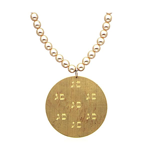 "Brass medallion on pearls, astrological sign 'Sagittarius"""