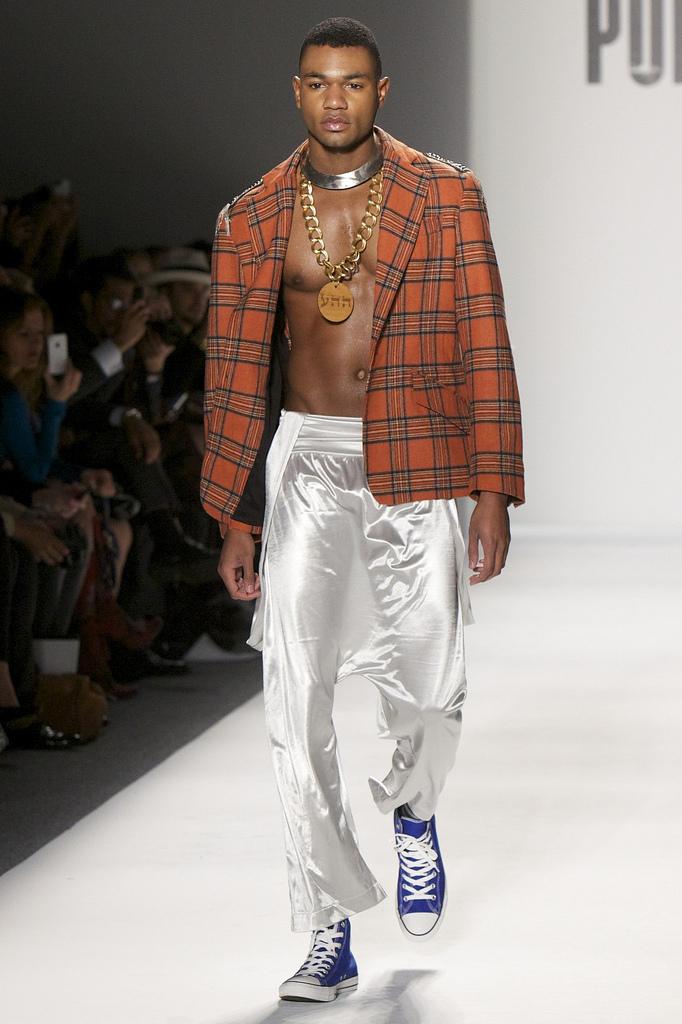 February 9, 2012: Mercedes Benz fashion week, wooden medallion Unconditional Love on vintage brass chain