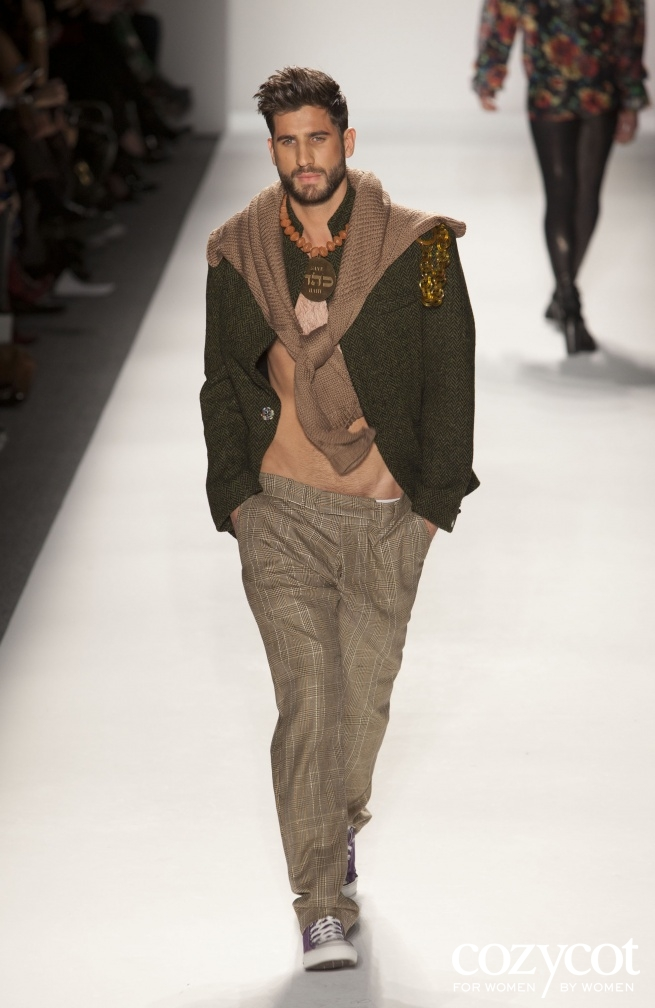 February 9, 2012: Mercedes Benz fashion week, copper medallion on clay beads