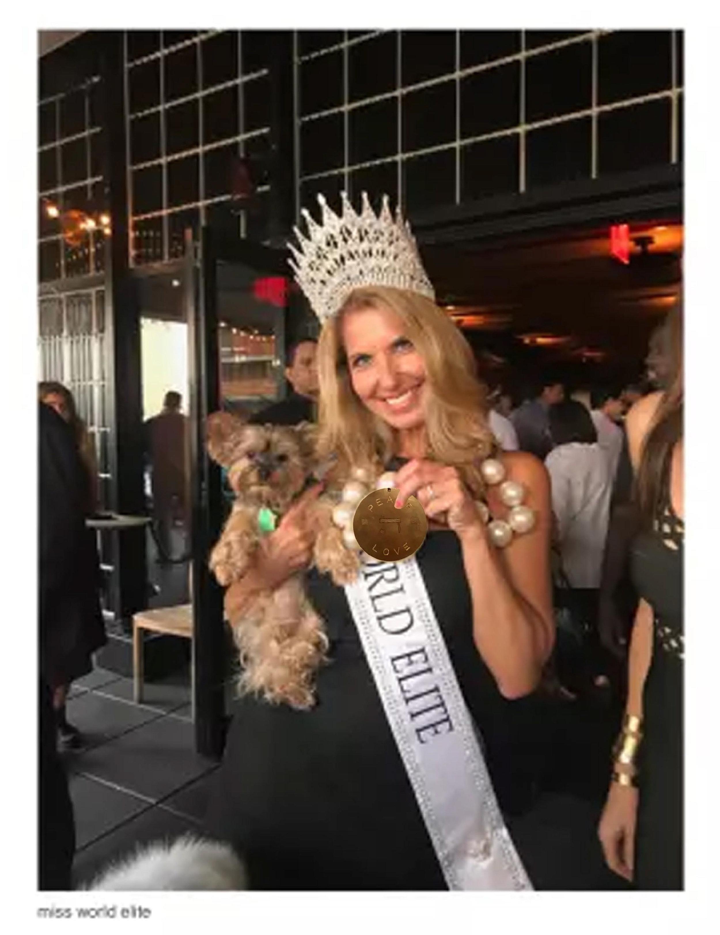 "Miss World Elite wearing runway ""happiness"" angel"