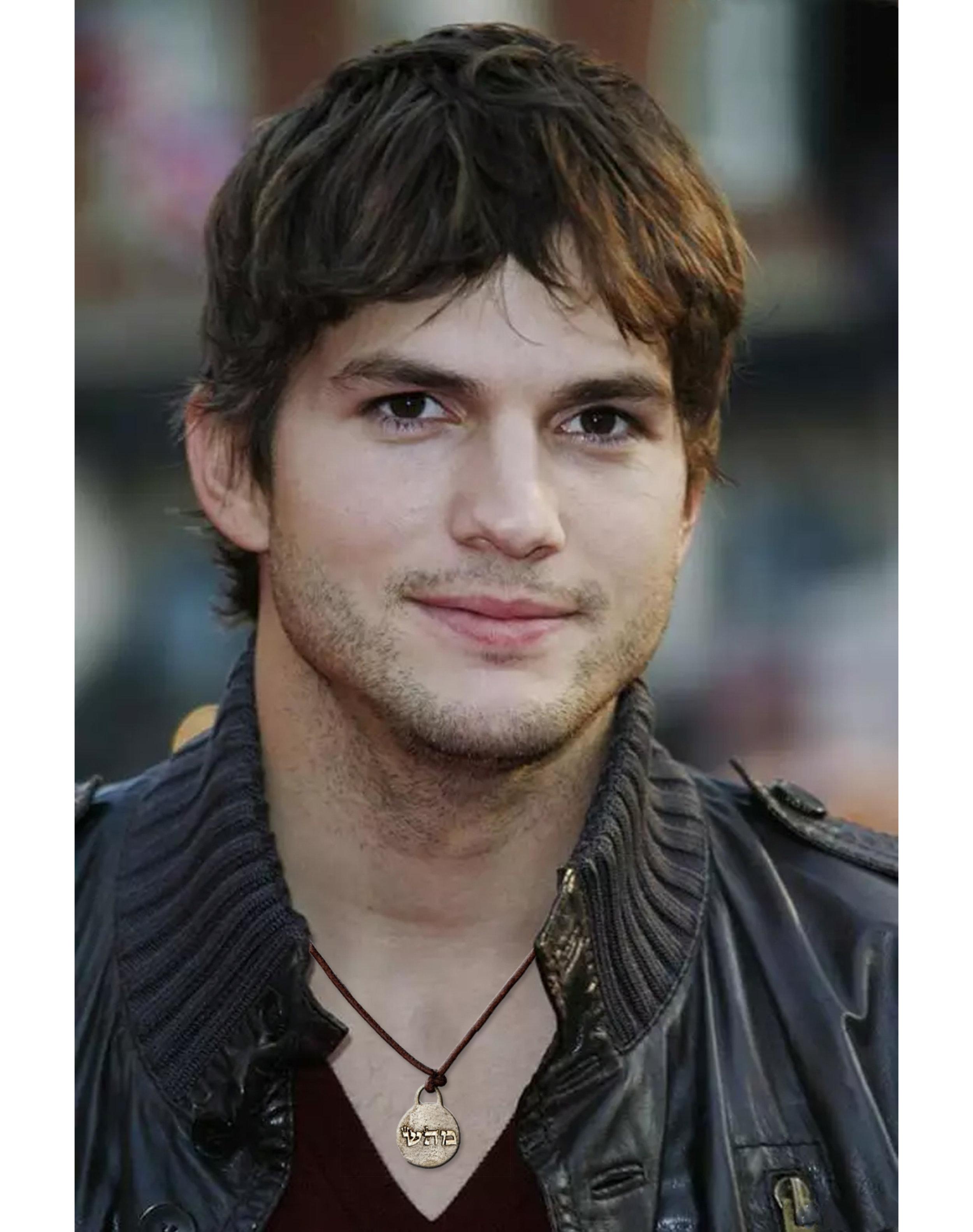 "Ashton Kutcher in ""healing"" angel necklace"
