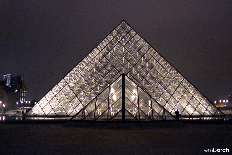 Louvre - exterior courtyard pyramids at night