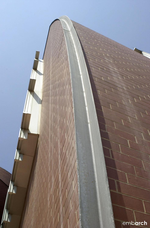 Curving brick masses.