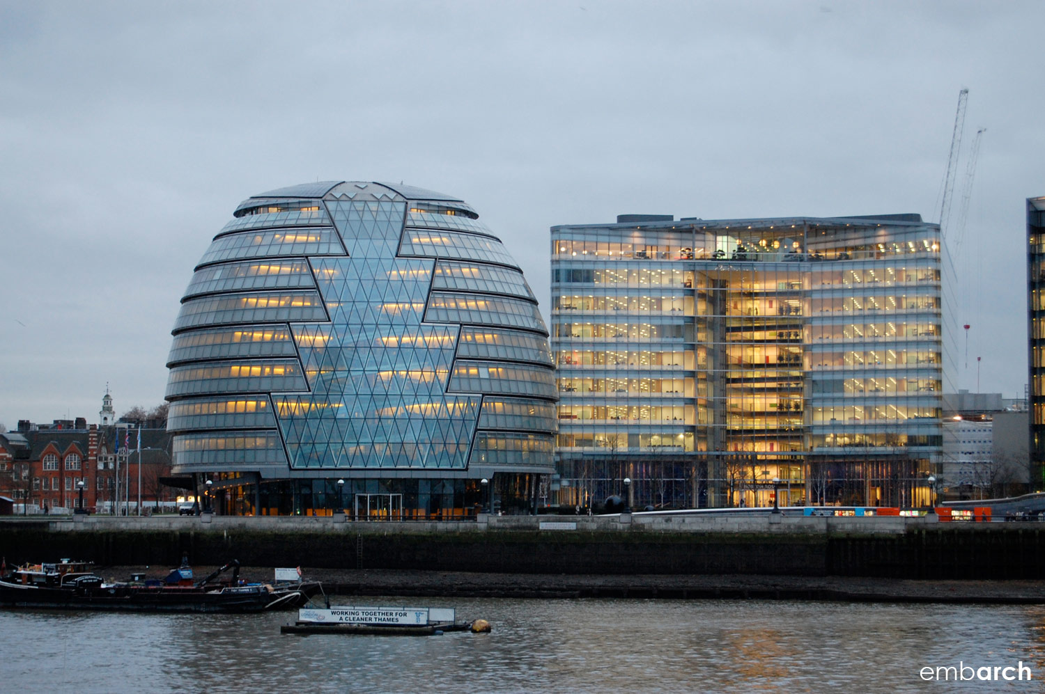 London City Hall - view of the building at dusk from across the River Thames.