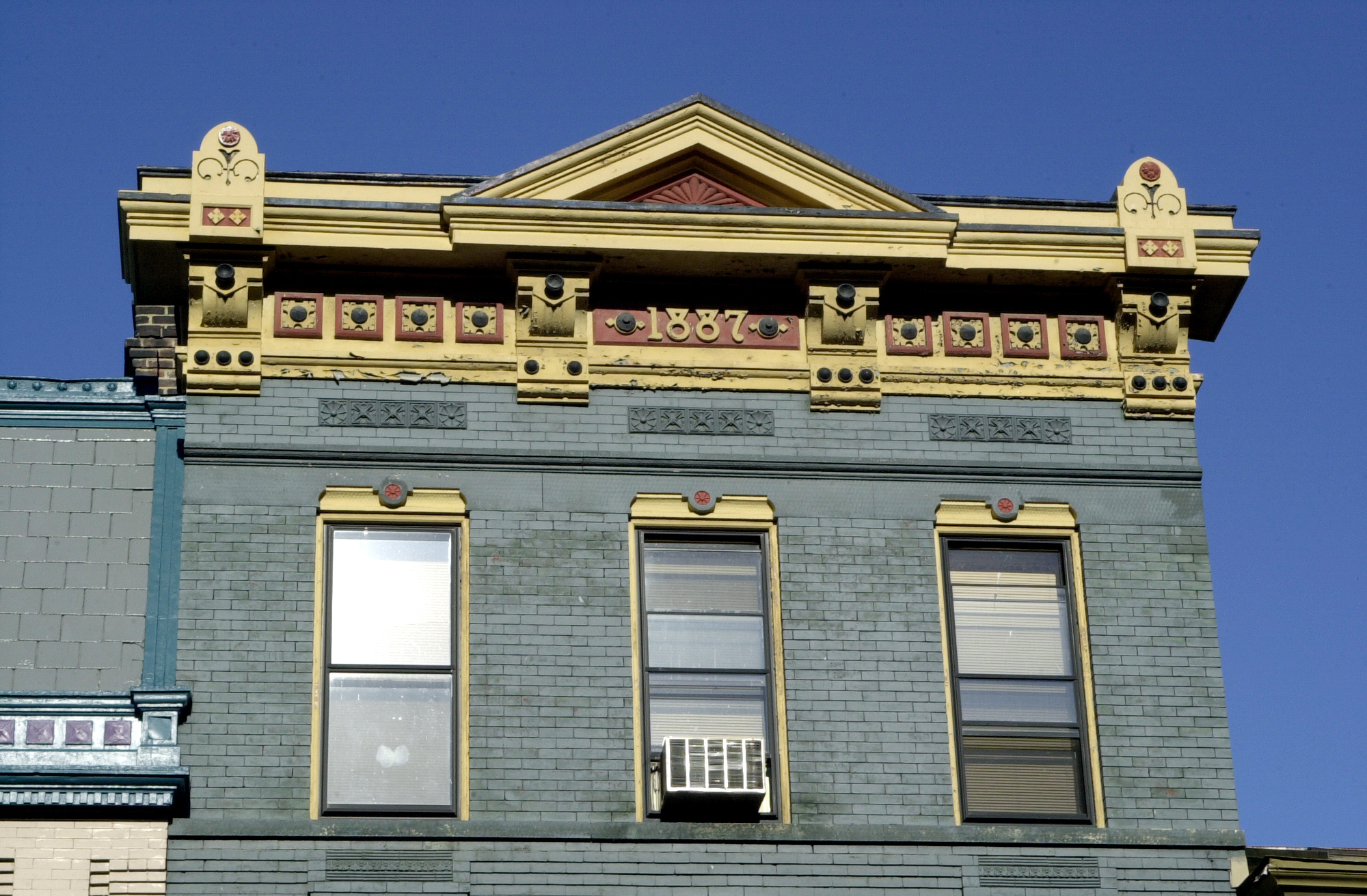 Colorful cornice work on a building built in 1887 on historic Elm Street.