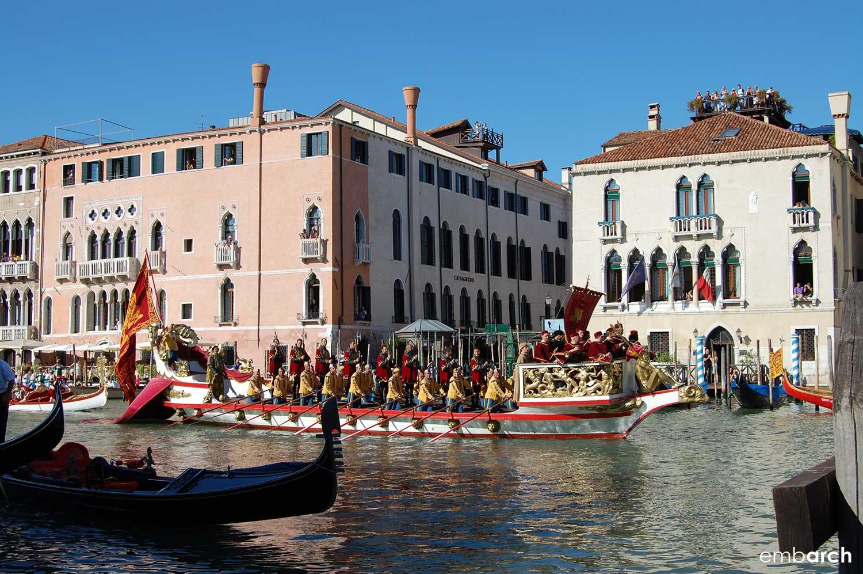 Colorful boats on the Grand Canal during the Regata Storica di Venezia.