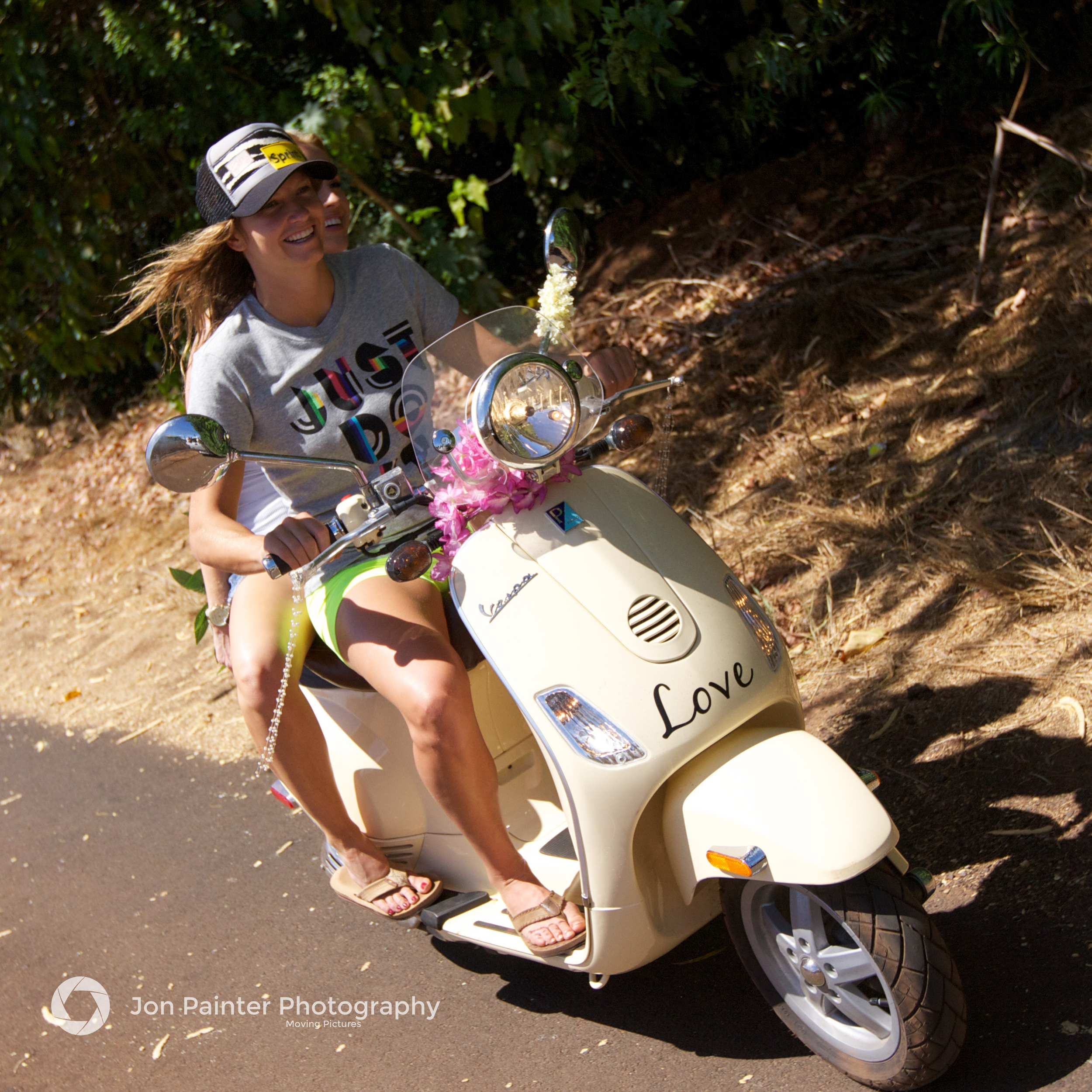 Julia Mancuso and Lauren Thompson riding Julia's Vespa. - Maui, Hawaii.