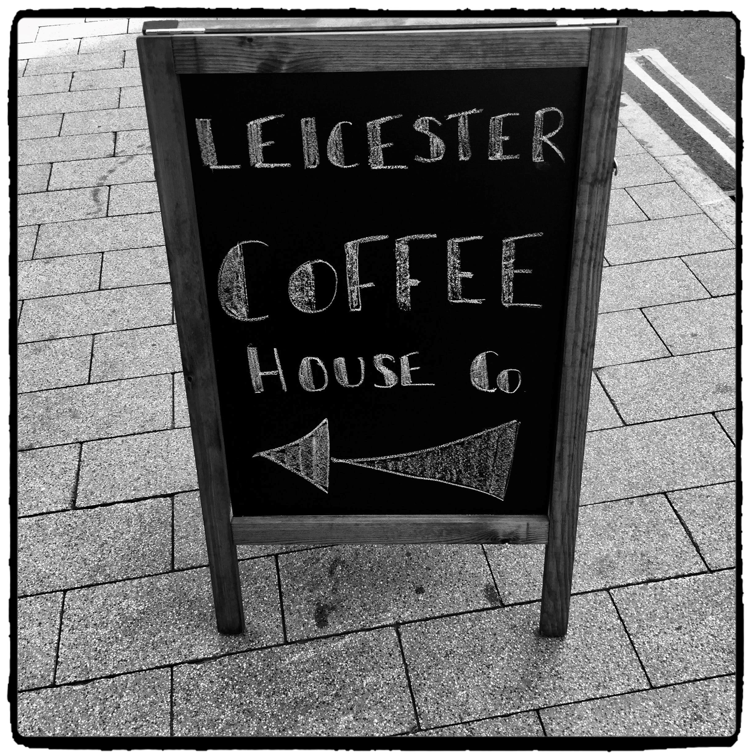 Sign pointing towards a great new coffee outlet on Granby Street, Leicester UK
