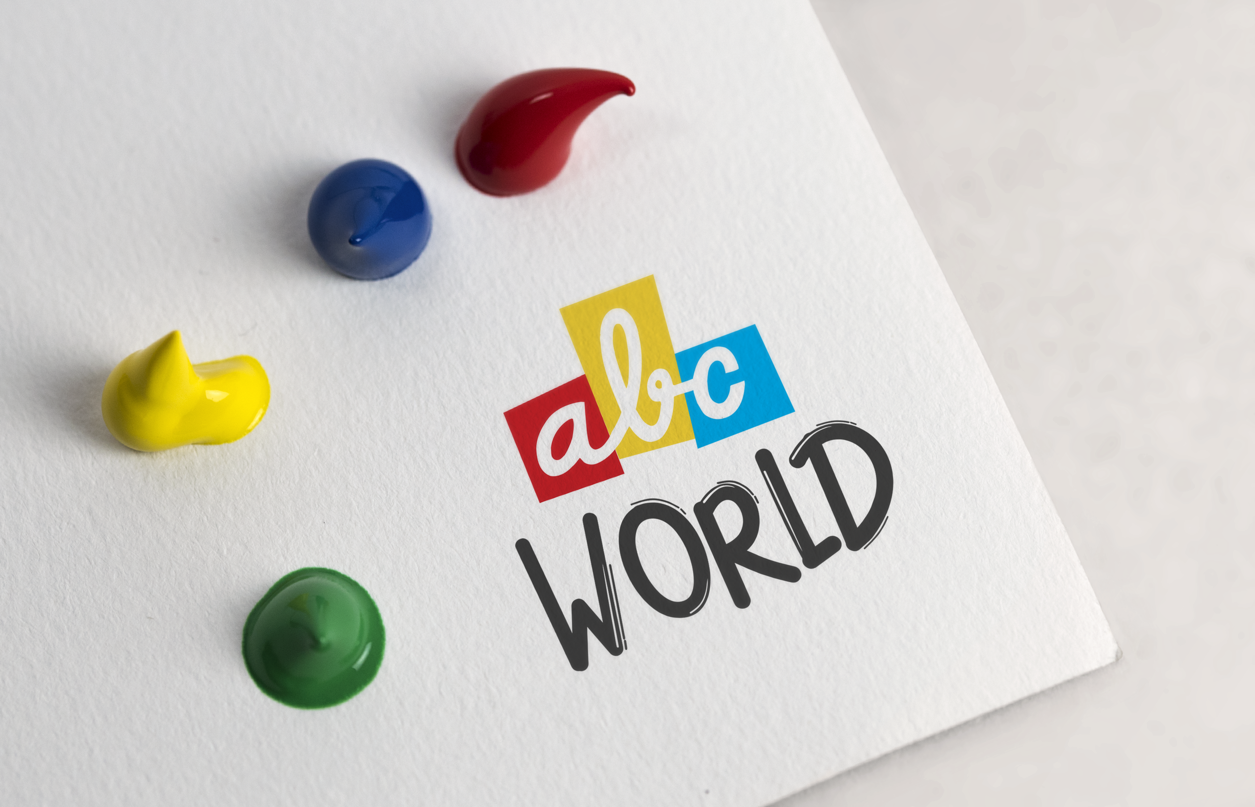 ABC_World_Logo_Paper_Mockup.png