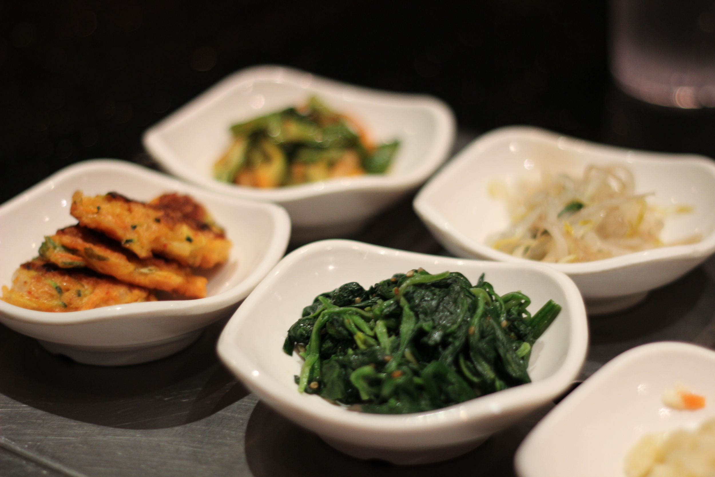 Sautéed spinach, kimchi pancakes and bean sprouts