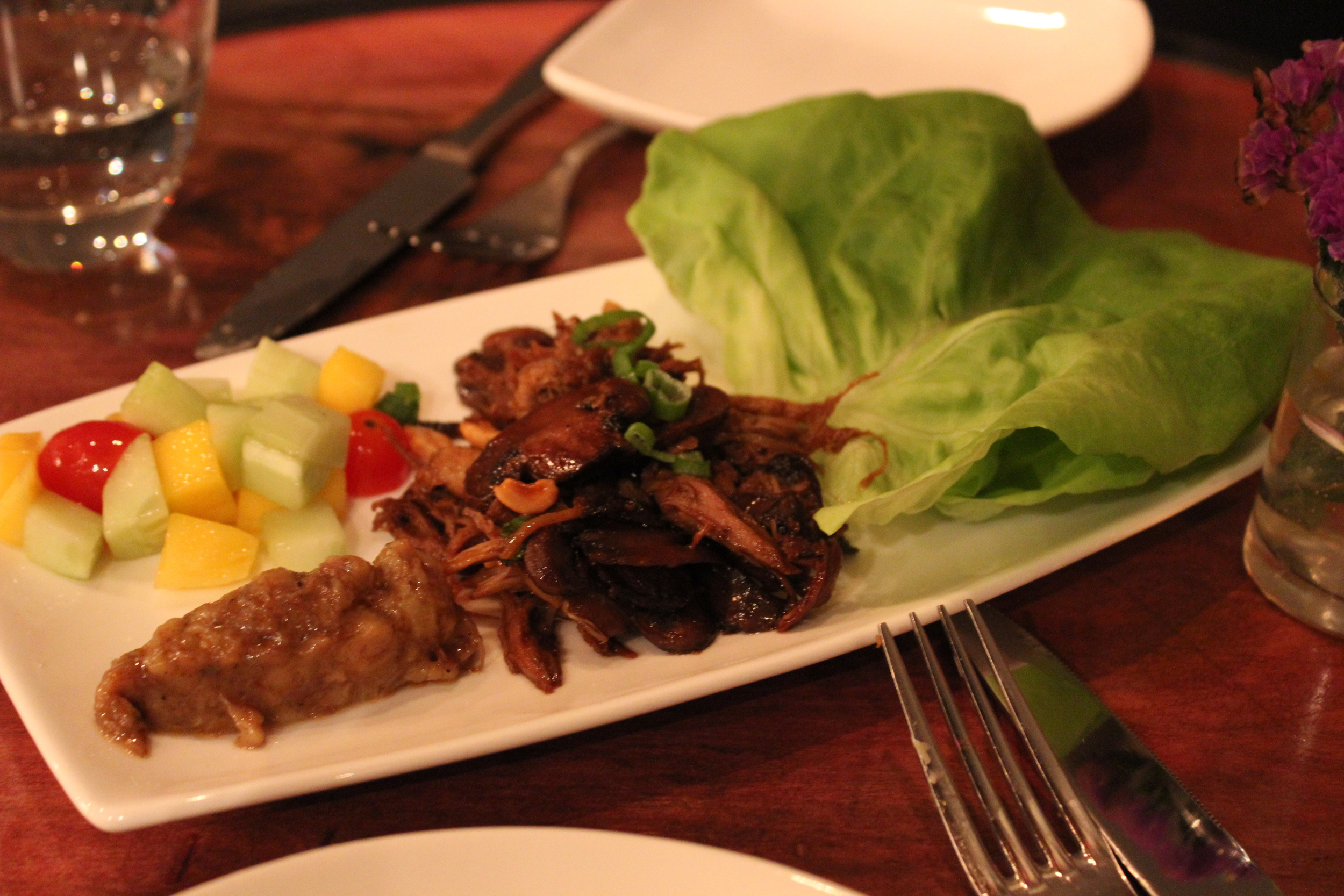 Course 4: Braised Duck Lettuce Wraps, Mushrooms, Picadillo, Raisins, Peanuts, Roasted Banana