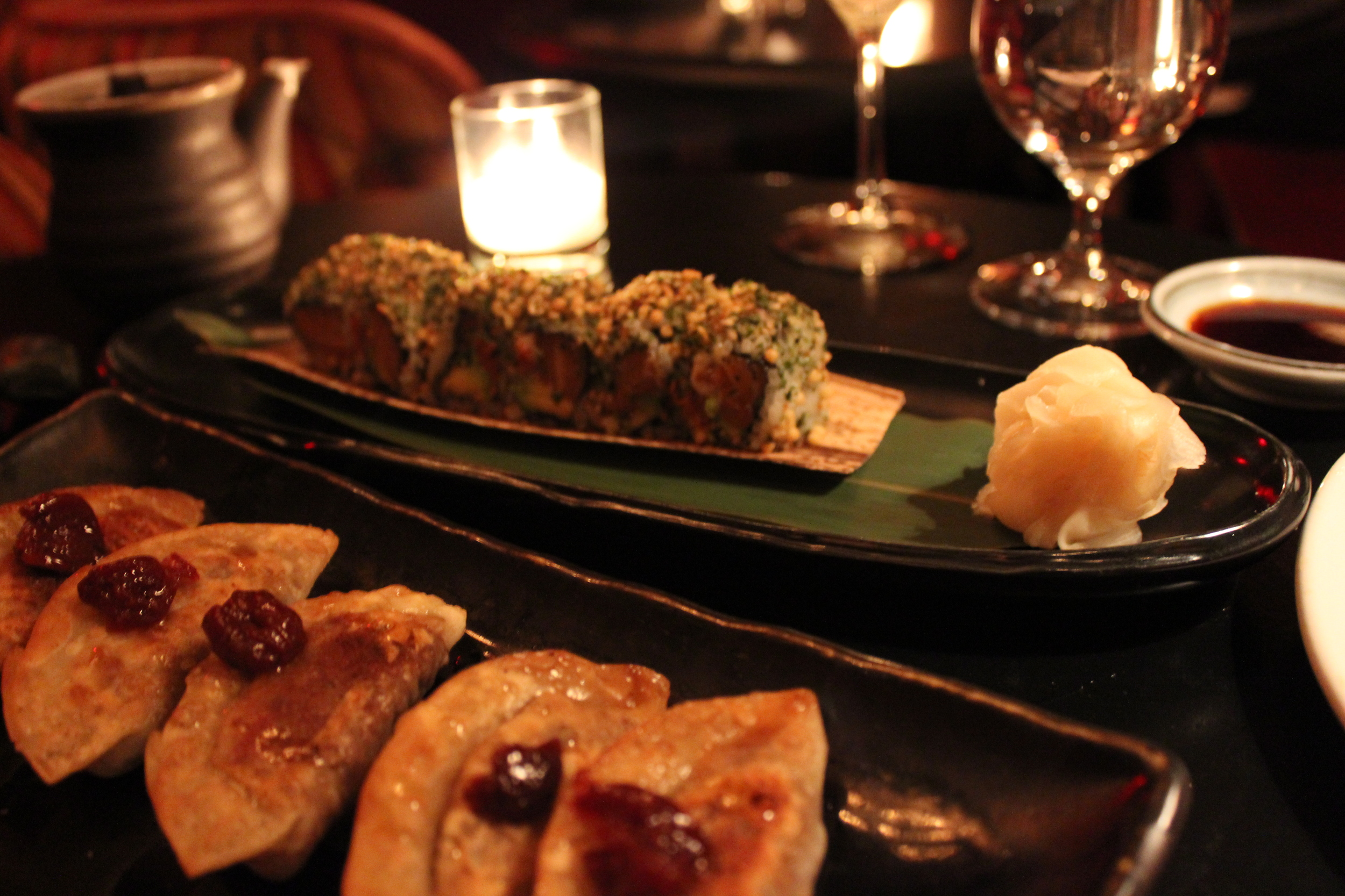 Foie Gras Shortrib Gyoza (front left) and Salmon Avocado Roll (back right)
