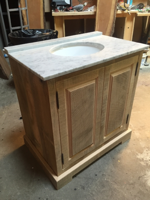 CUSTOM: This custom vanity made by Scott McKinnon Custom Carpentry was yet another element that completed the space. It's simple door style & slight rustic aesthetic provided warmth & texture.