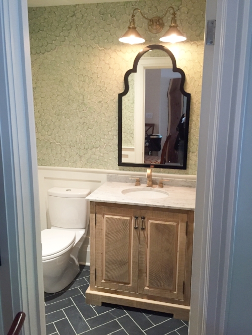 AFTER: The final reveal! The Powder Room is now a brilliant space which functions more efficiently for this growing family. The herringbone slate floors add interest, while the wallpaper provided some much-needed personality.
