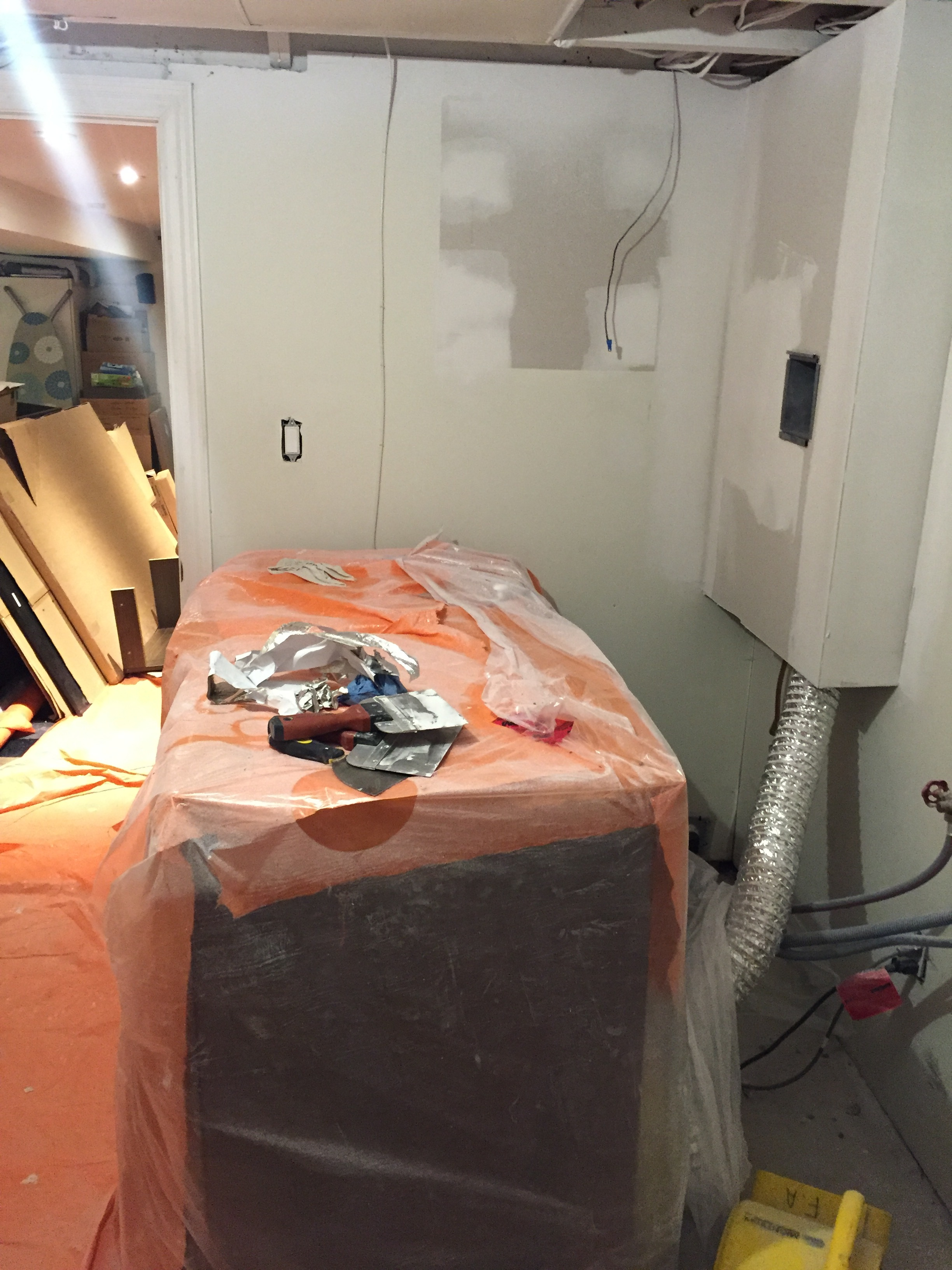 FRAMING & DRYWALL: We also had to build out the wall to conceal the dryer vent. We debated stacking the Washer/Dryer, but keeping them side by side seemed more practical.