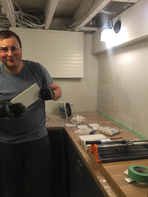 Here is my husband Kris excitedly trying his hand at laying tile for the first time! It's starting coming together!