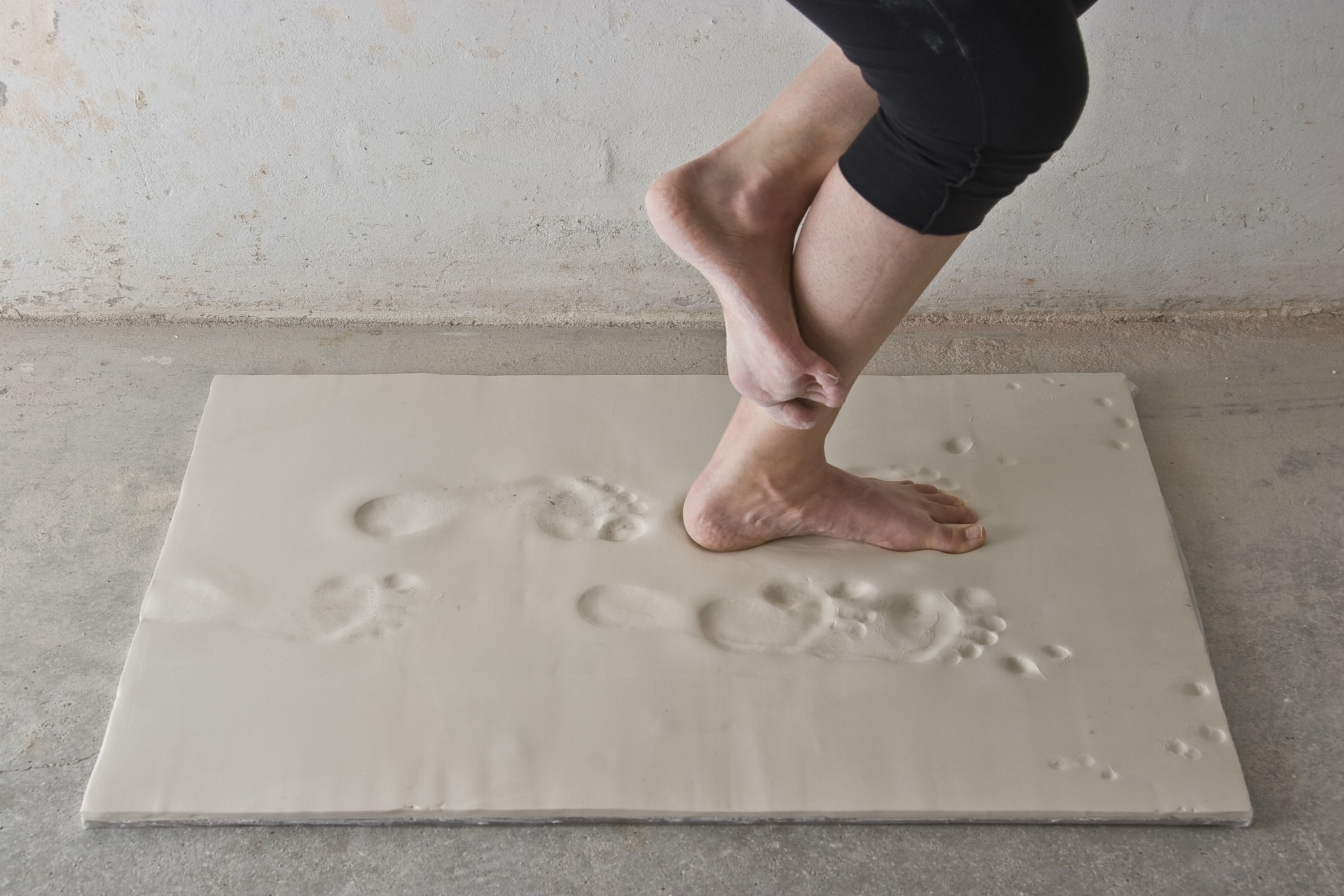 Untitled, performance on unfired porcelain, dimensions variable, 2010