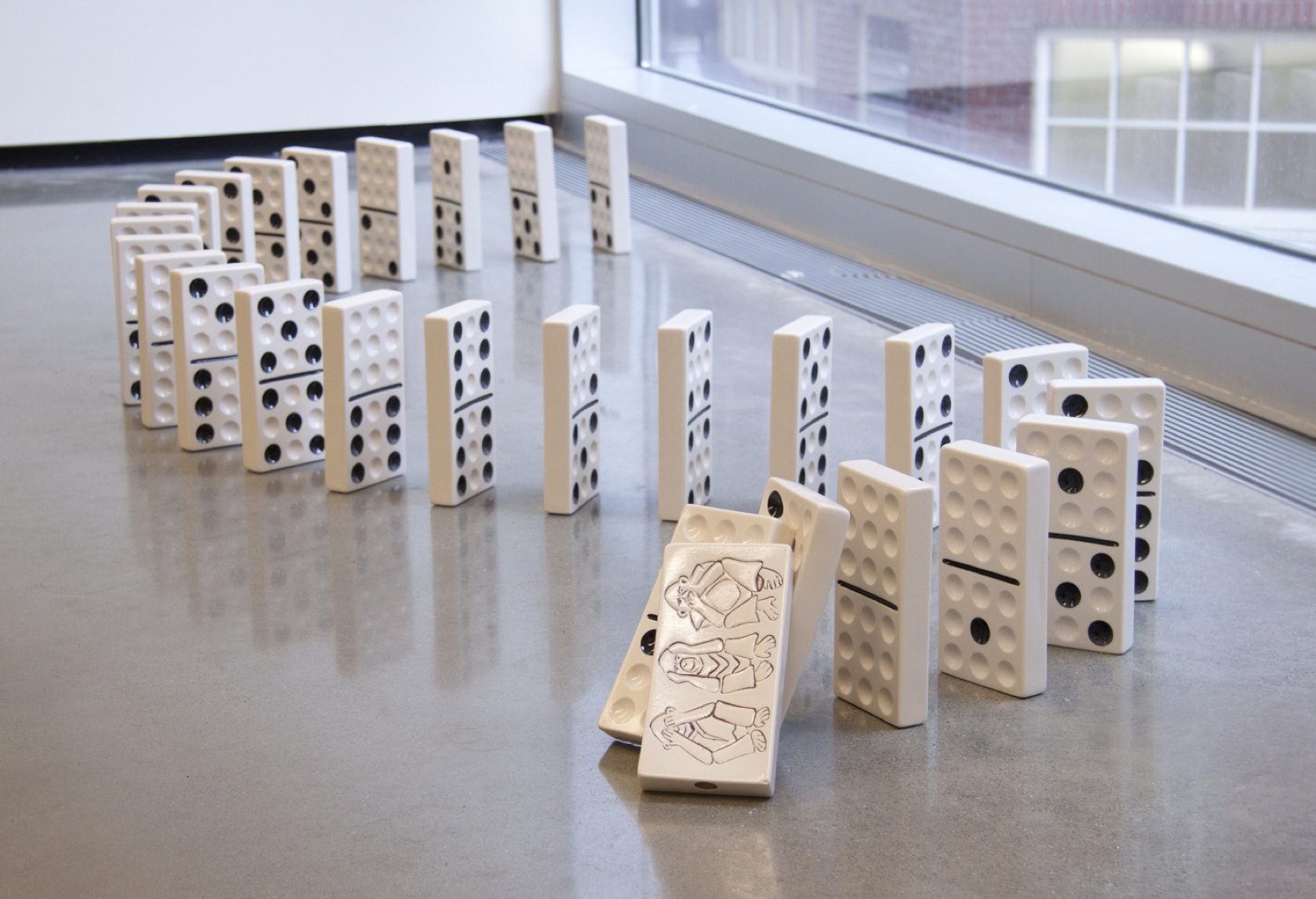 """Mischief in the Boneyard, porcelain, each piece 4"""" x 1"""" x 7"""", overall dimensions variable, 2011"""