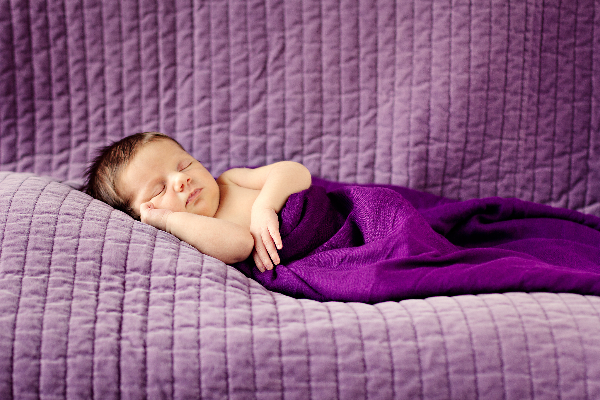 Why should you hire a professional newborn photographer?