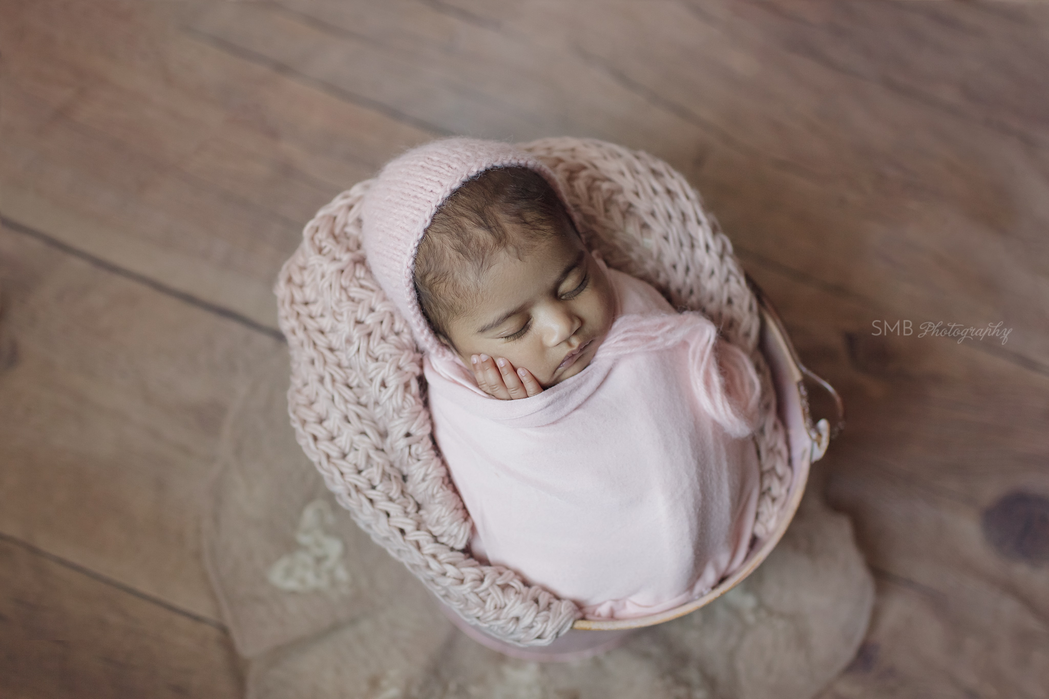 Baby girl wrapped inside a pink bucket