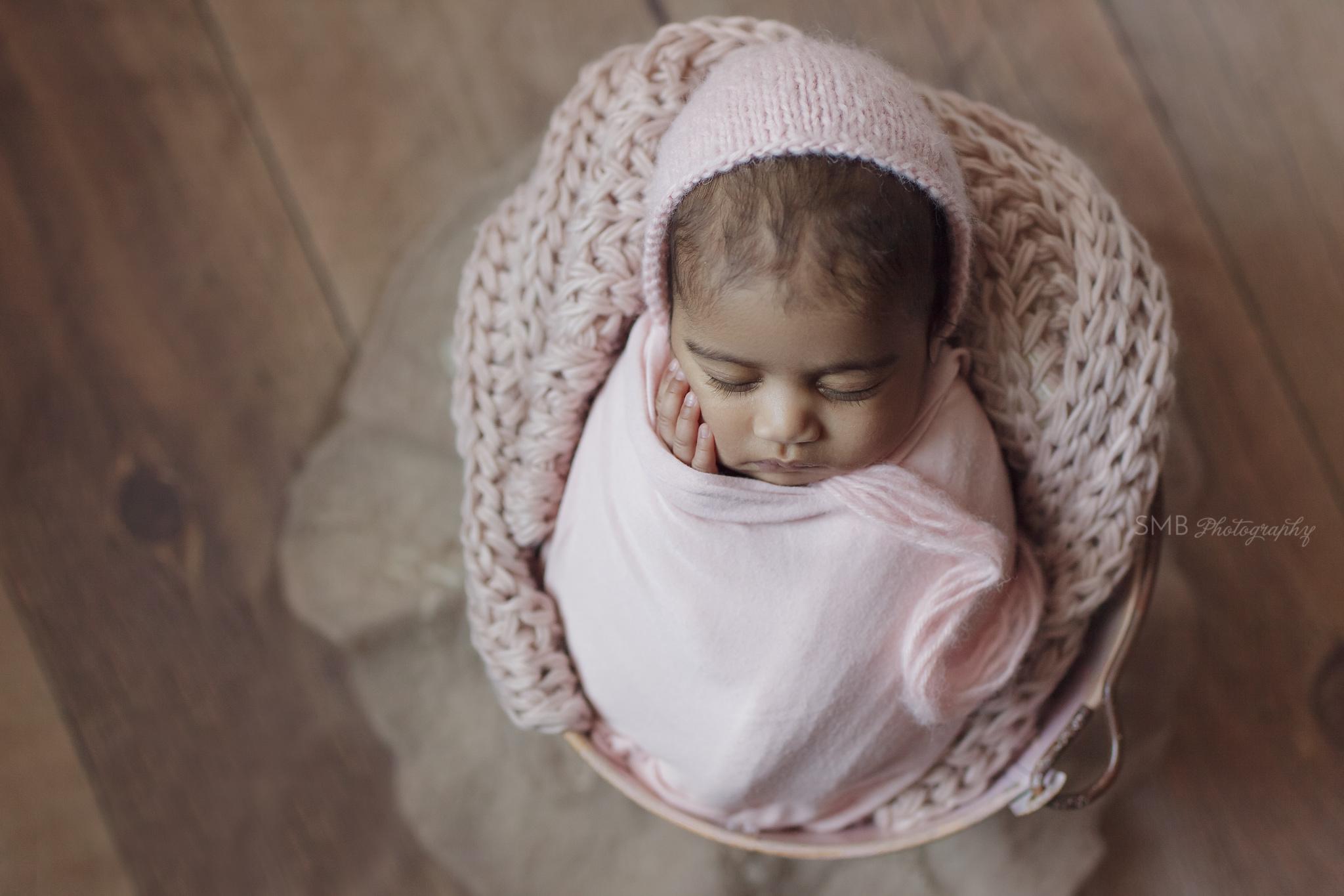 Baby girl wearing a pink bonnet