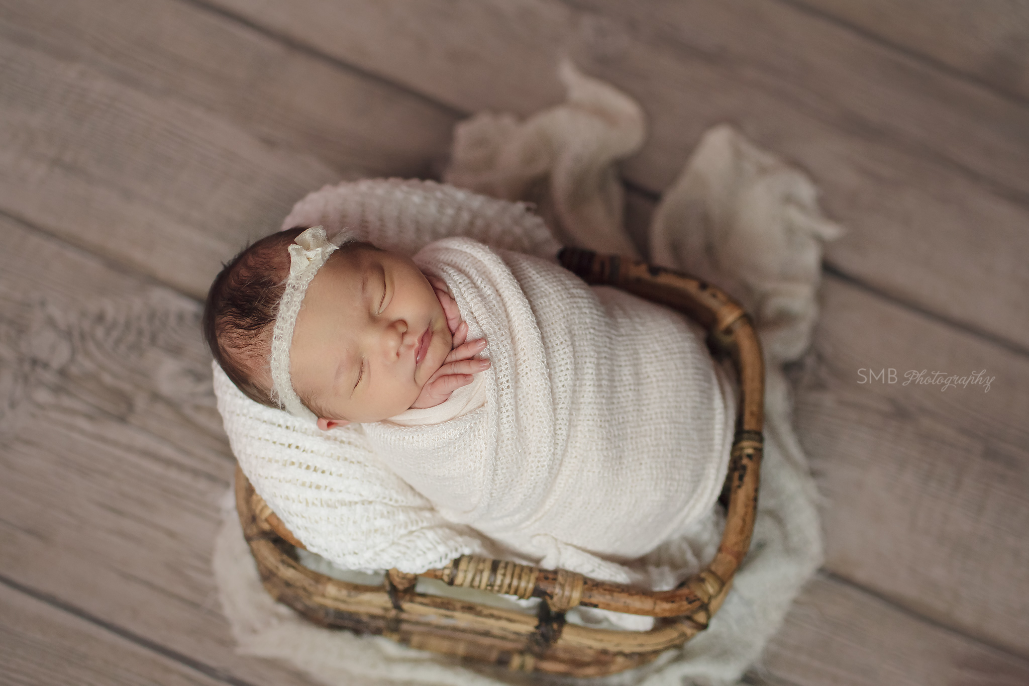 New baby girl wrapped in basket