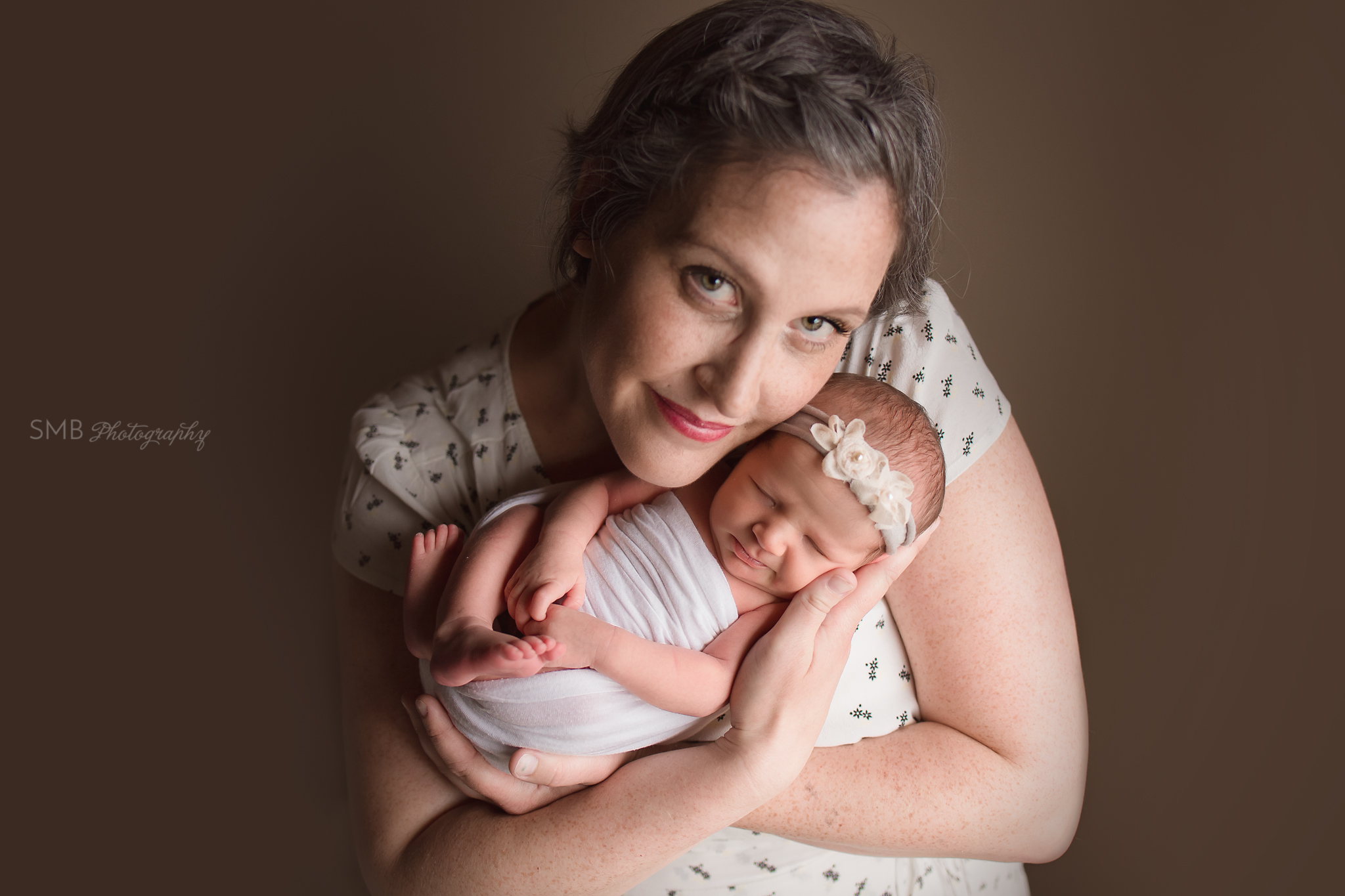 Mom holding newborn daughter